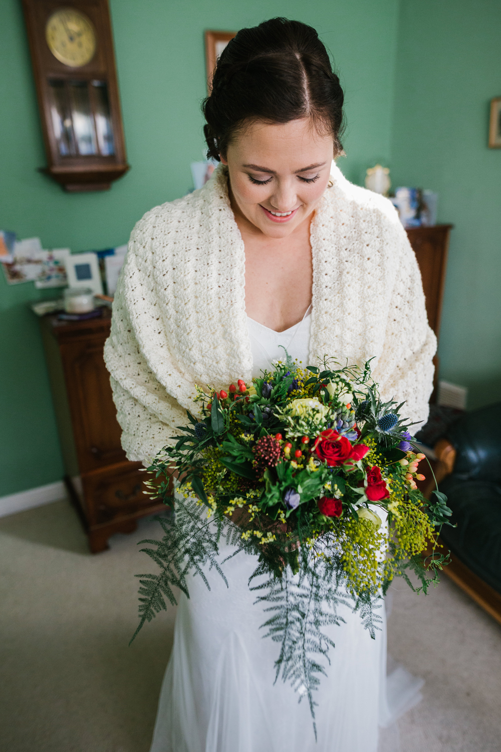 bride with bouquet in crocheted shawl by Emma and Rich