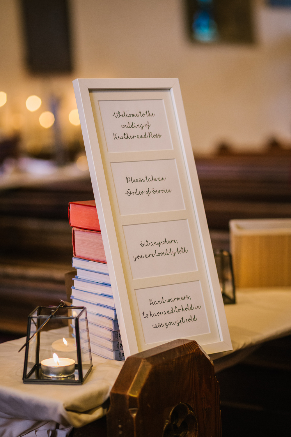 wedding sign in church by Emma and Rich
