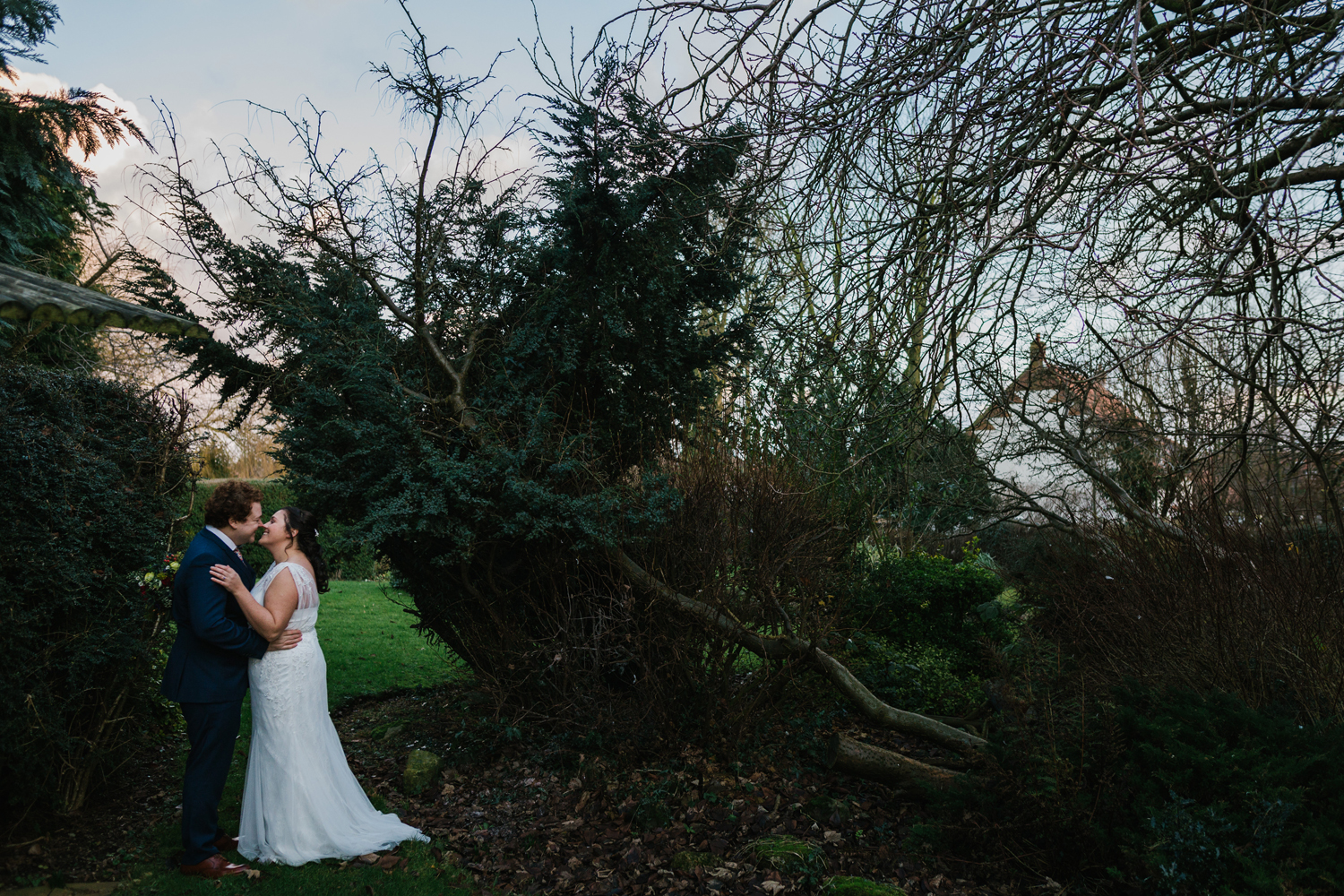 bride and groom in wrangham house gardens by Emma and Rich