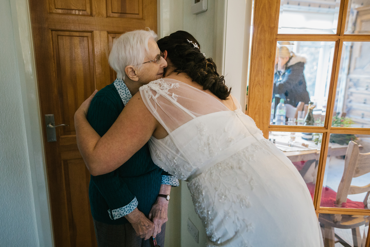 bride hugging grandma by Emma and Rich