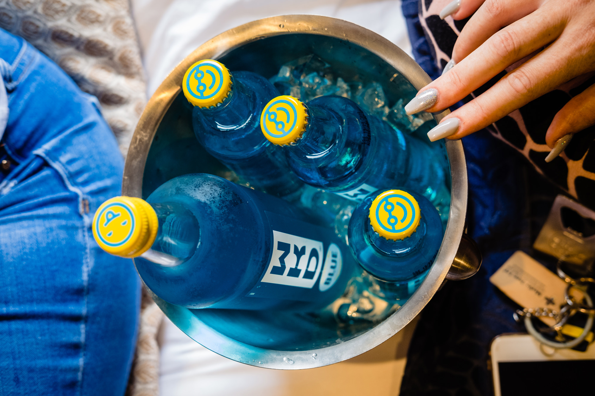 bottles of blue wkd in a wine cooler.