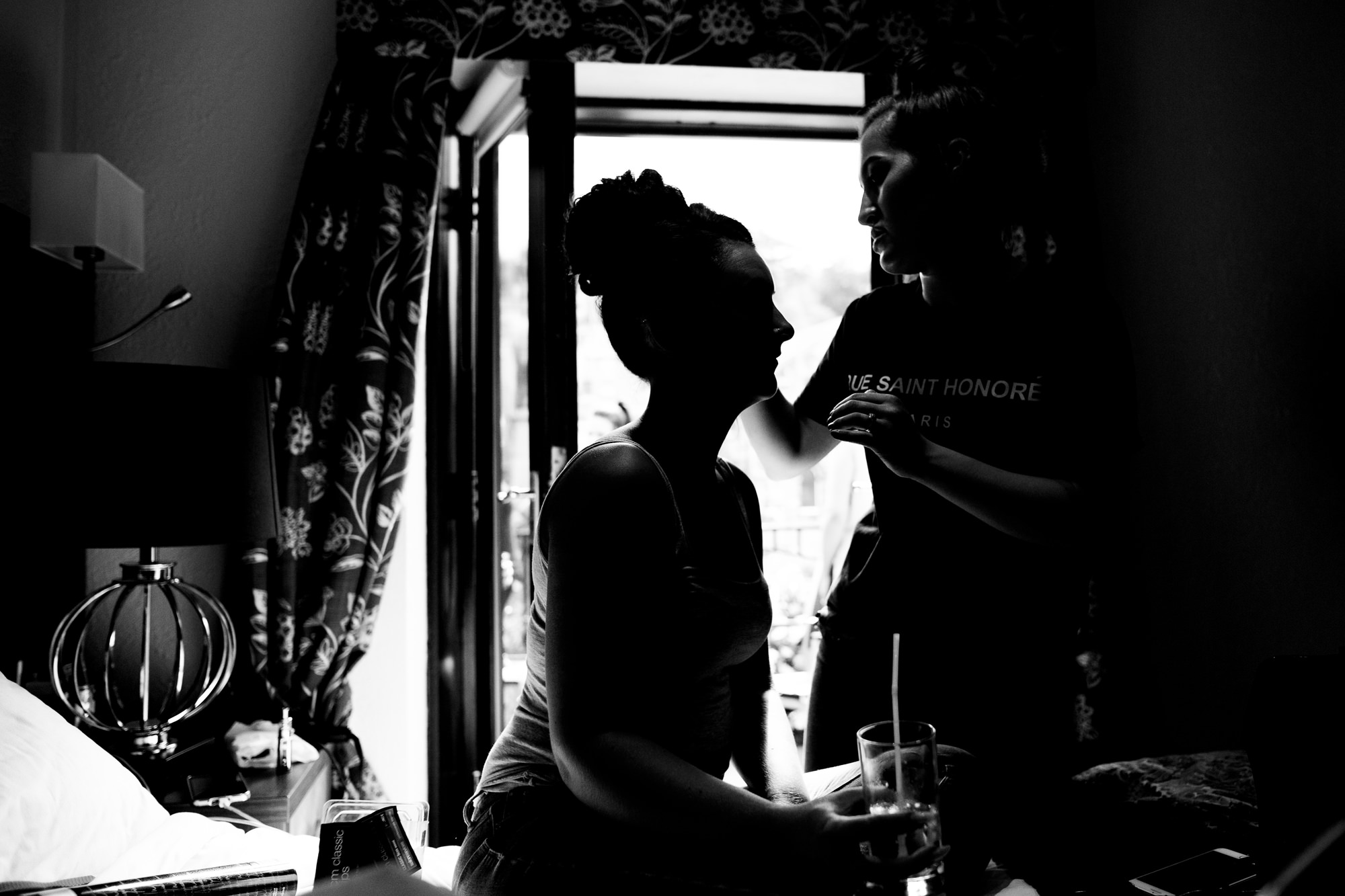 silhouette of a bride having her make-up done. huntsman inn wedding photography by emma and rich.