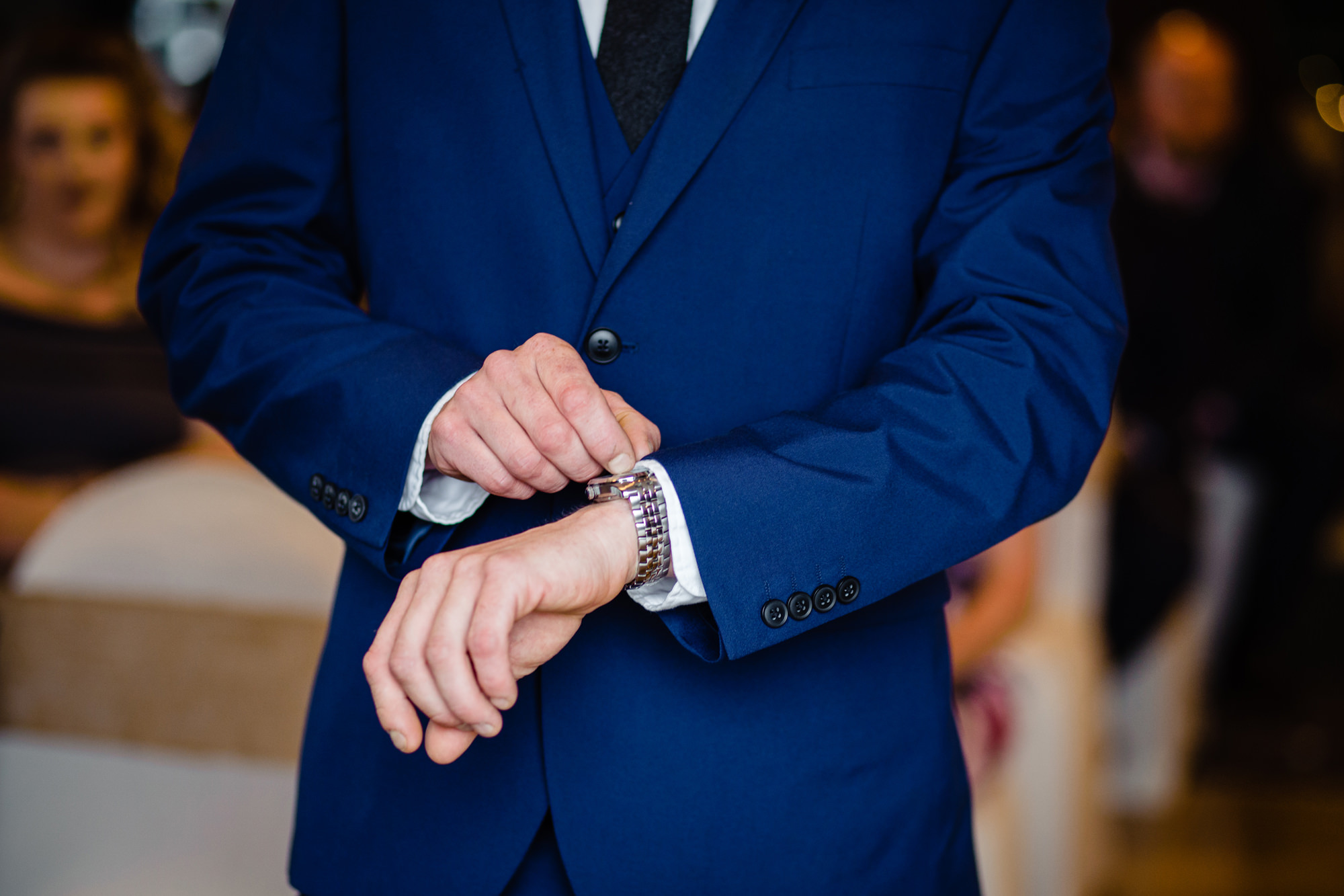 close up of the grooms hands as he checks his watch before the ceremony. huntsman inn wedding photography by emma and rich.