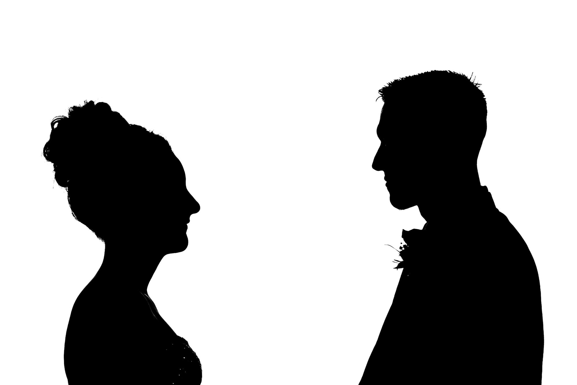 silhouette of couple facing each other during wedding ceremony. huntsman inn wedding photography by emma and rich.