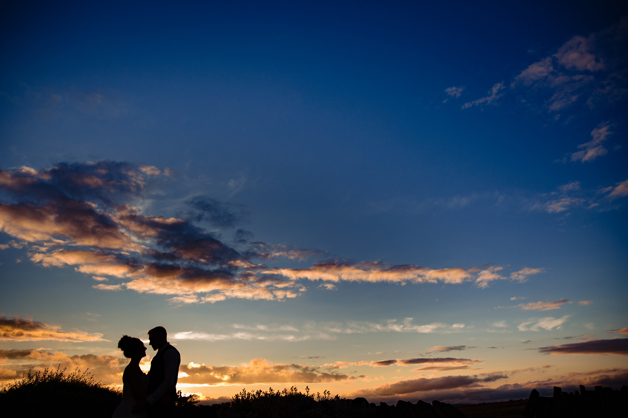 couple portrait in front of the sunset. huntsman inn wedding photography by emma and rich.