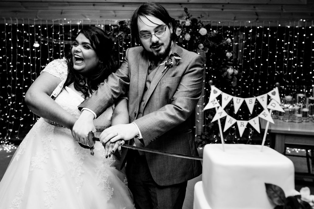 Maddie and Mike cutting their wedding cake at Styal Lodge