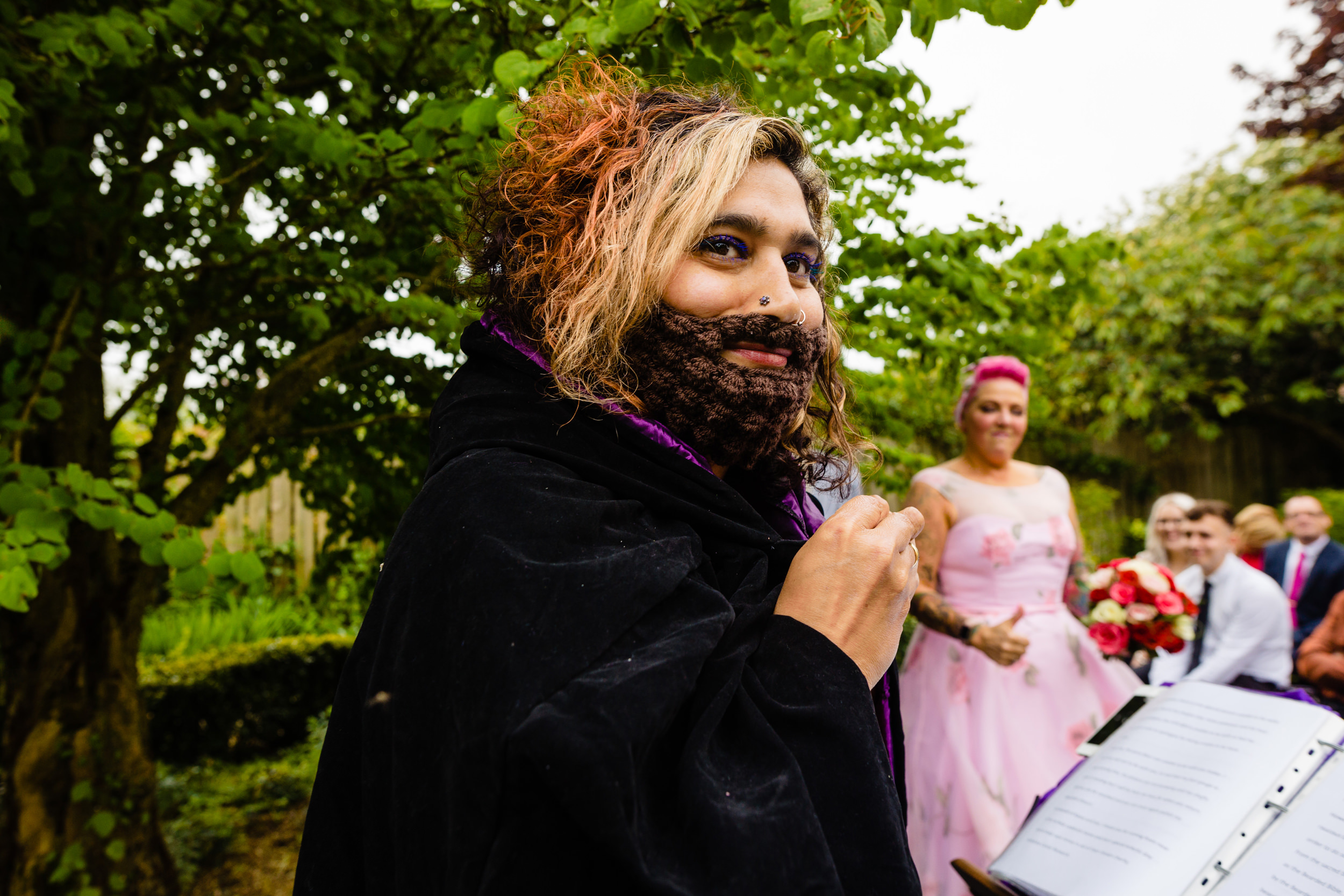 a wedding celebrant wearing a knitted beard leads the ceremony. wold top brewery wedding photography by emma and rich.