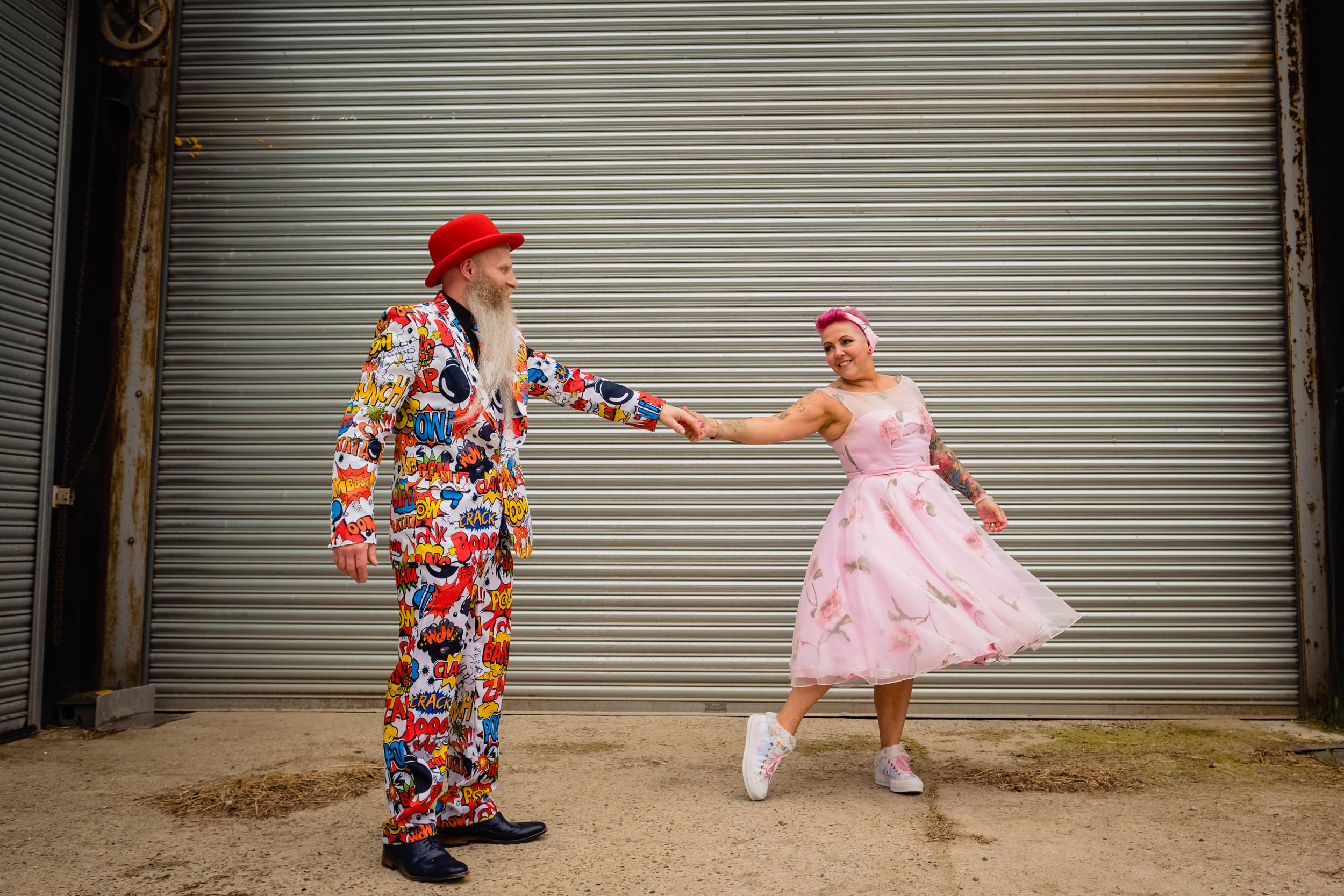 bride and groom dancing in a farmyard. wold top brewery wedding photography by emma and rich.