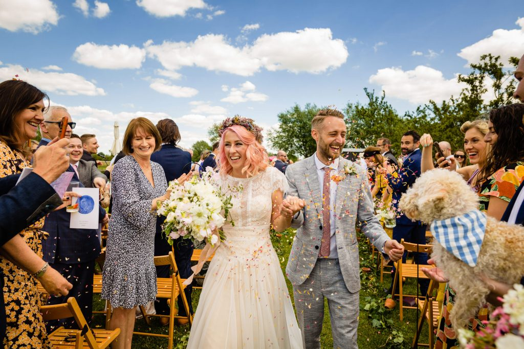 bride and groom recessional at outdoor wedding. maybush wedding co wedding photography by emma and rich.