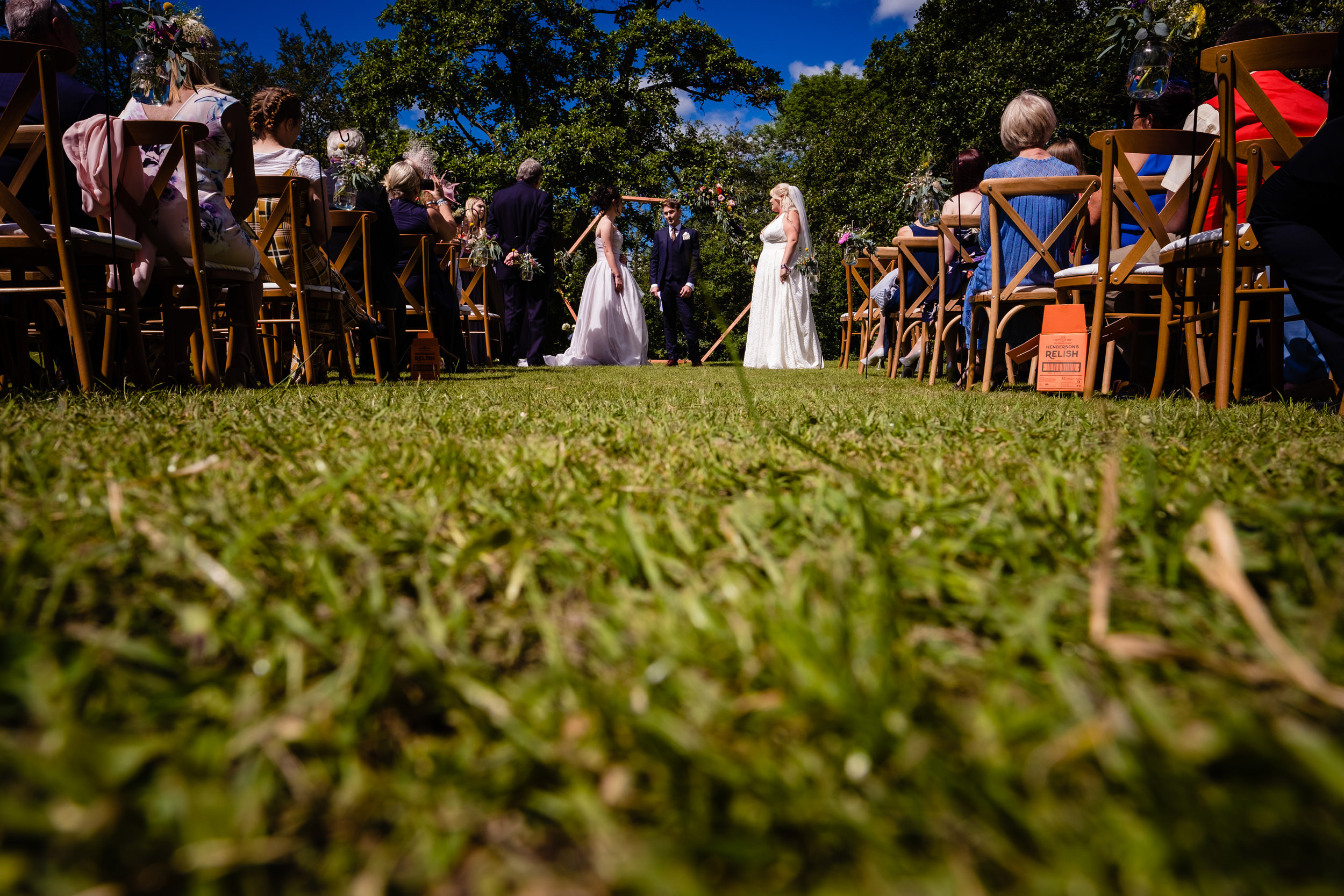 two brides face each other at front of wedding. plough inn, hathersage wedding photography by emma and rich.