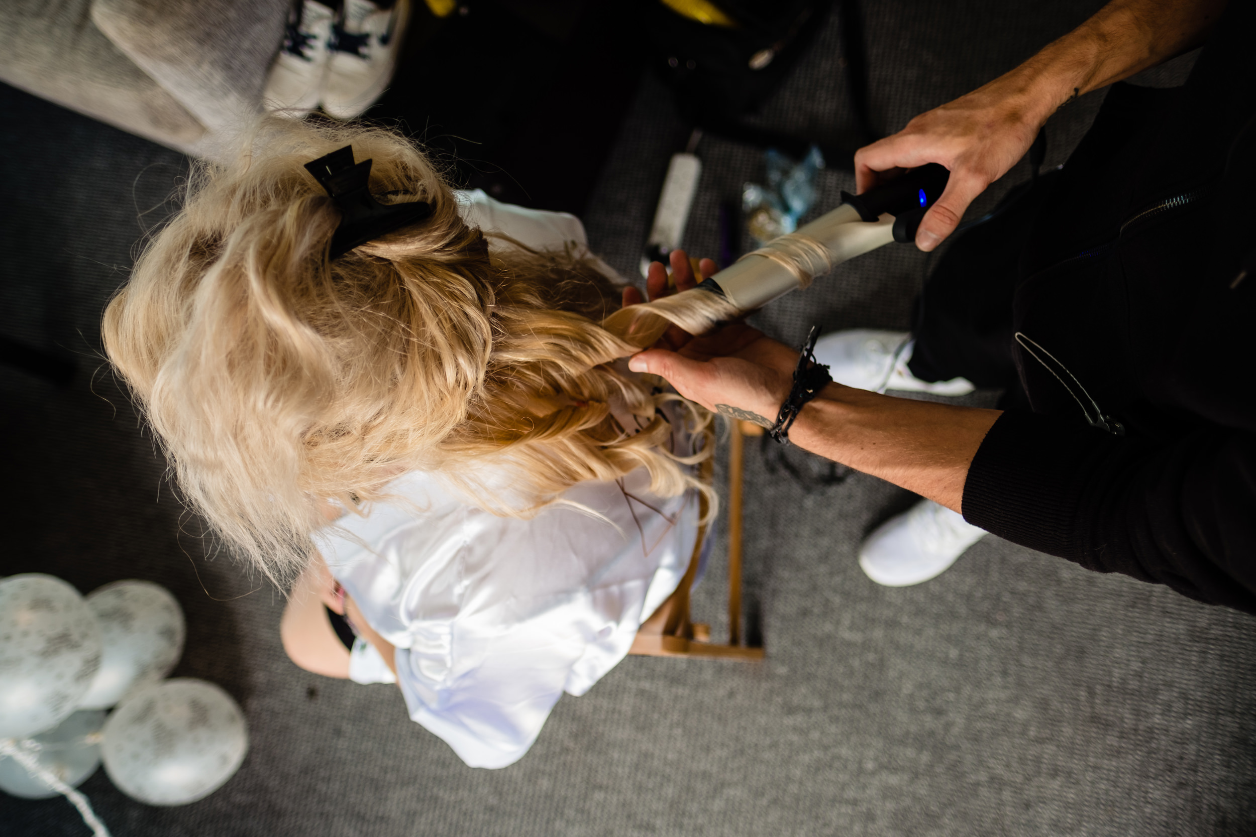 bride getting her hair curled. plough inn, hathersage wedding photography by emma and rich.