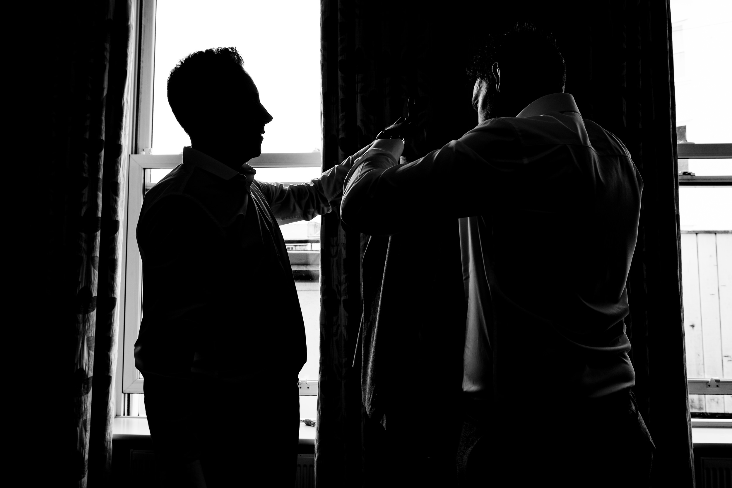 groom and best man getting ready at crown spa hotel. wildwood and eden wedding photography by emma and rich.
