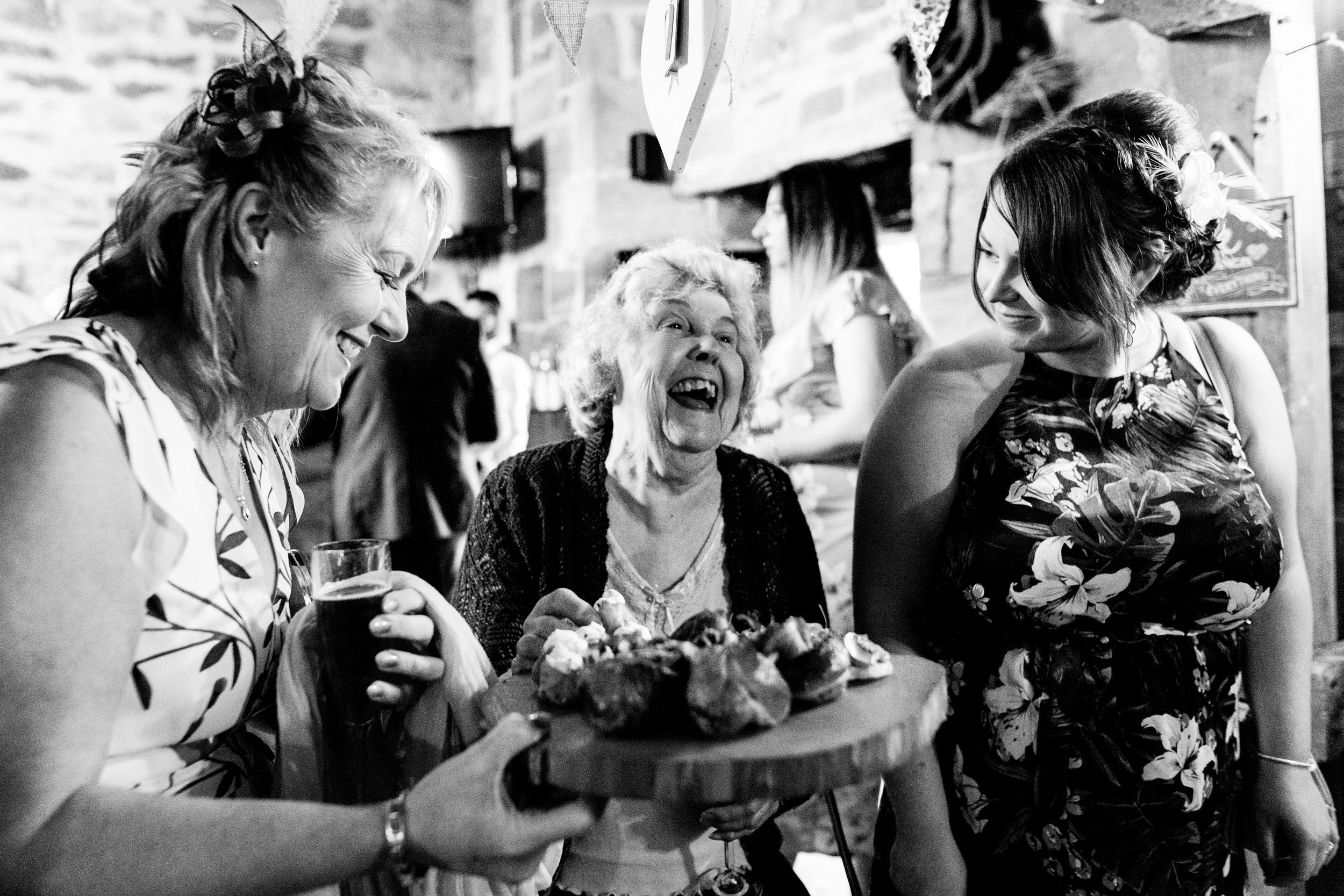 guests enjoying canapes. esk valley wedding photography by emma and rich.