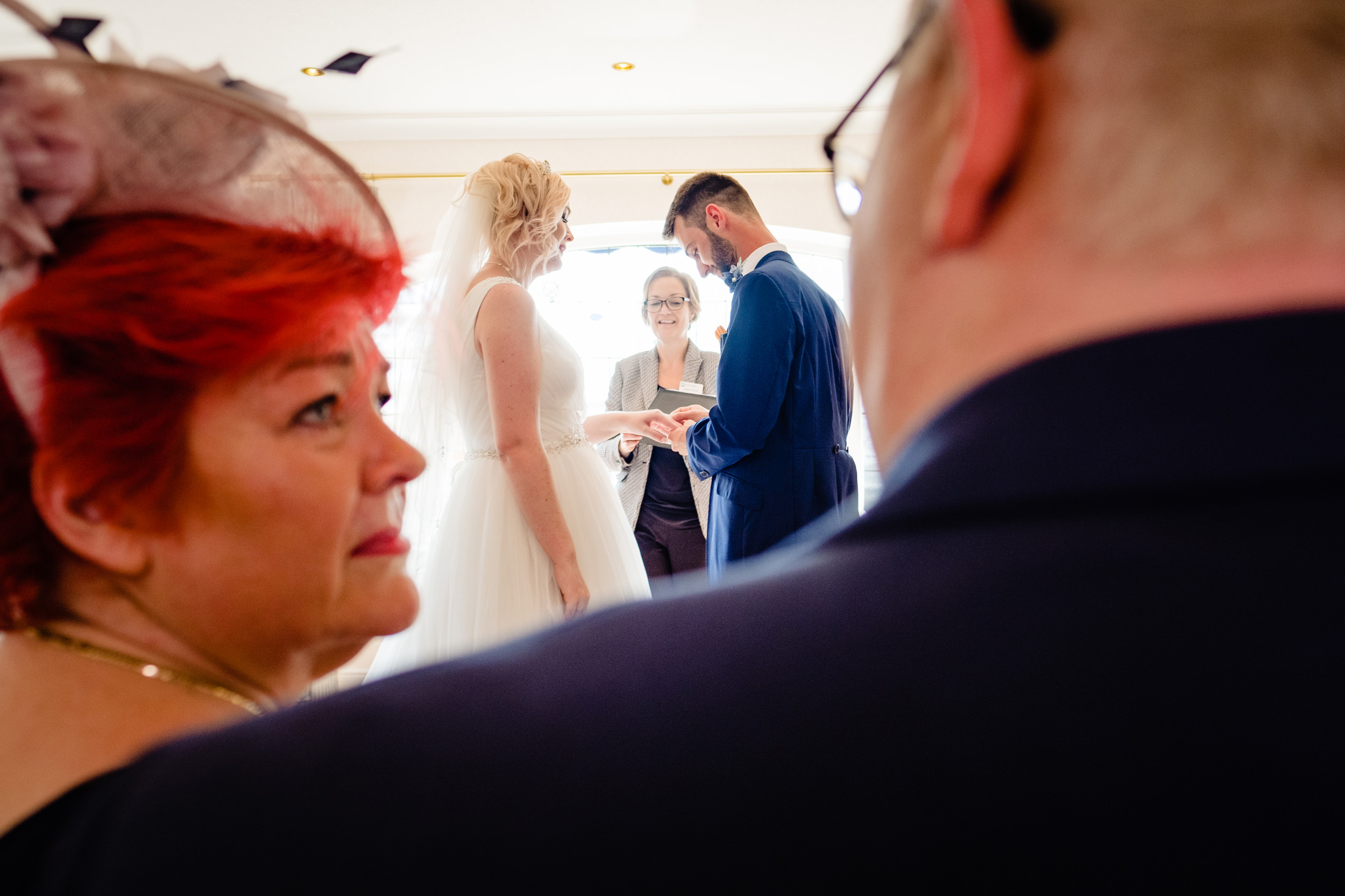 parents watch as daughter gets married. grand hotel scarborough wedding photography by emma and rich.