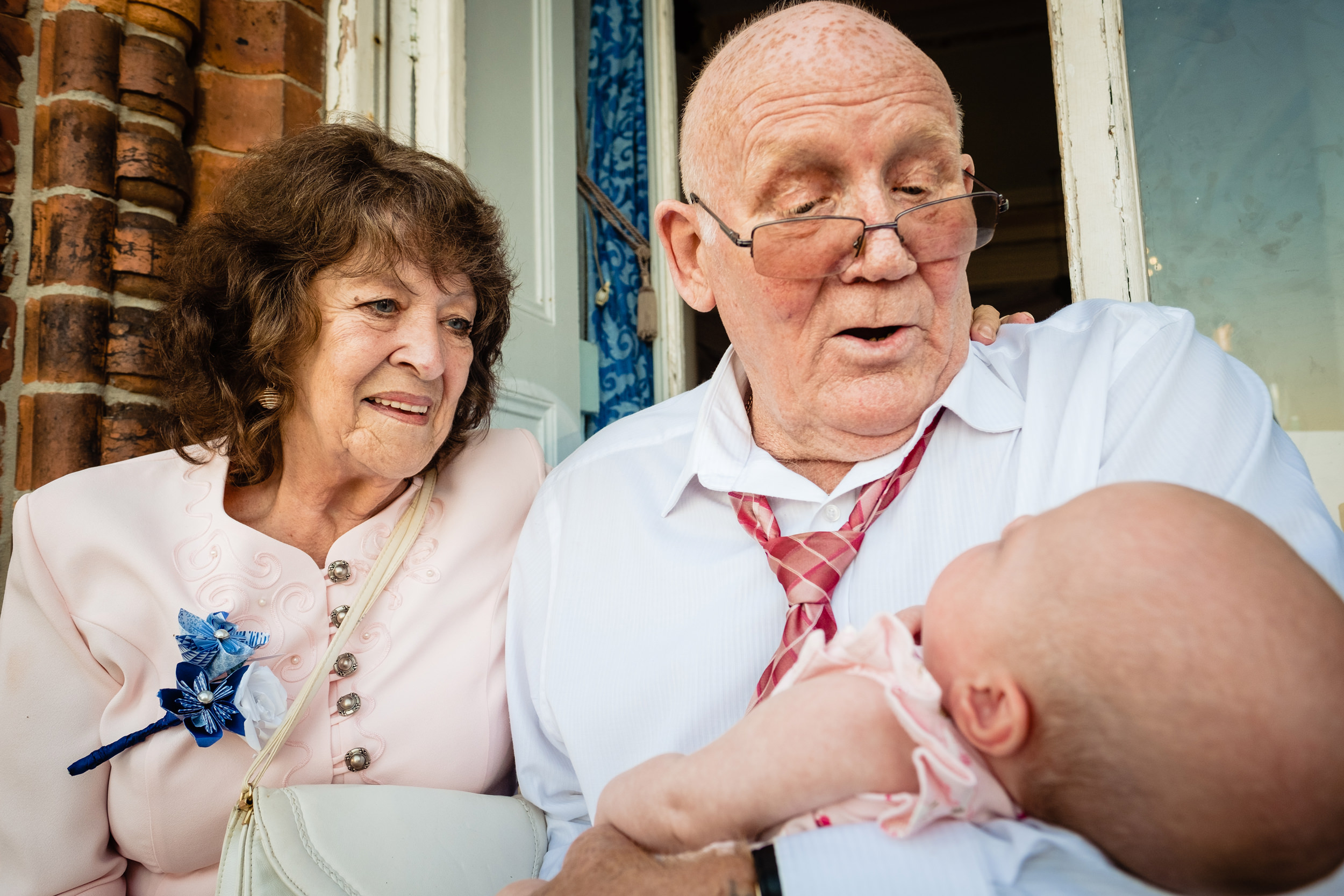 grandparents holding baby. grand hotel scarborough wedding photography by emma and rich.