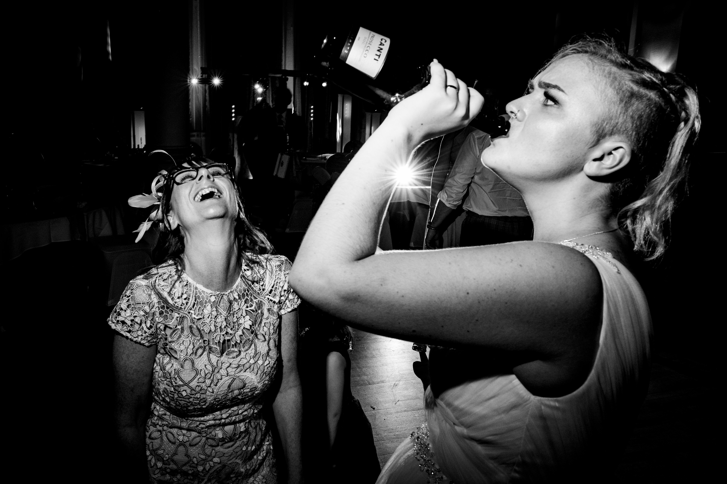 bride drinking wine from bottle. grand hotel scarborough wedding photography by emma and rich.