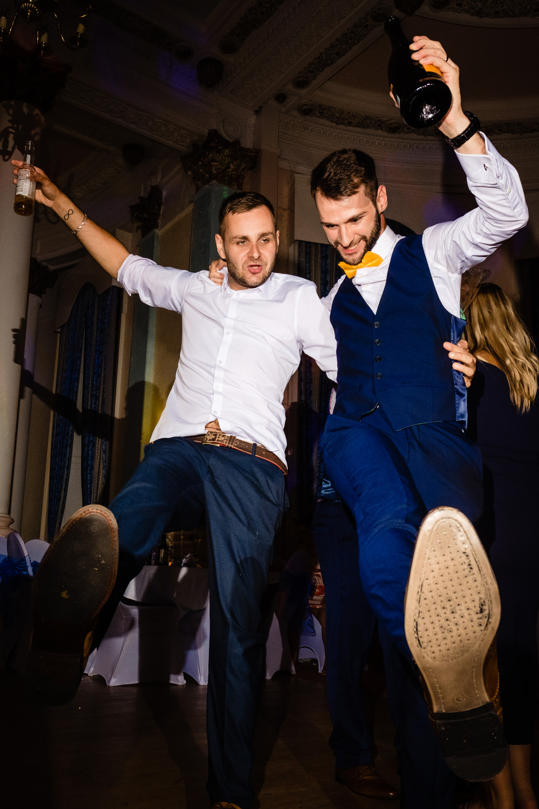groom dancing with groomsman. grand hotel scarborough wedding photography by emma and rich.