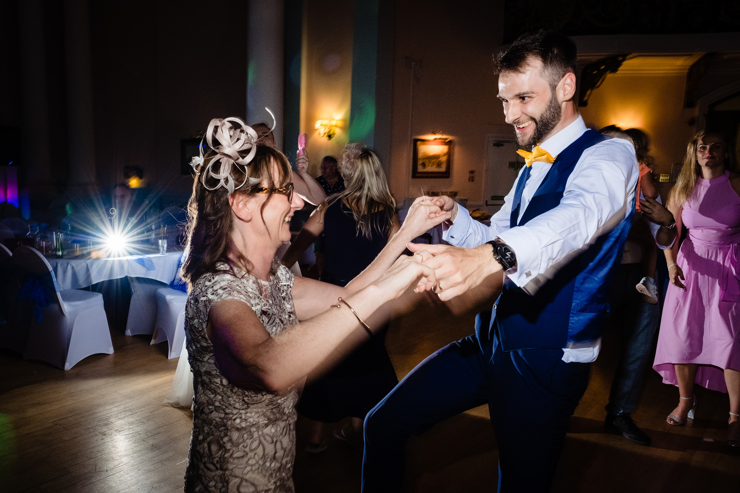 groom dancing with mum. grand hotel scarborough wedding photography by emma and rich.