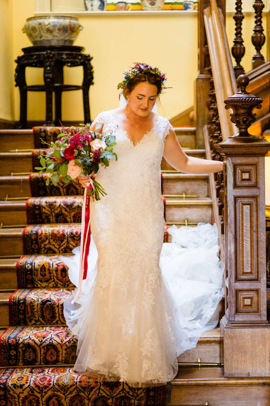 bride walking down stairs. scotland wedding photography by emma and rich.