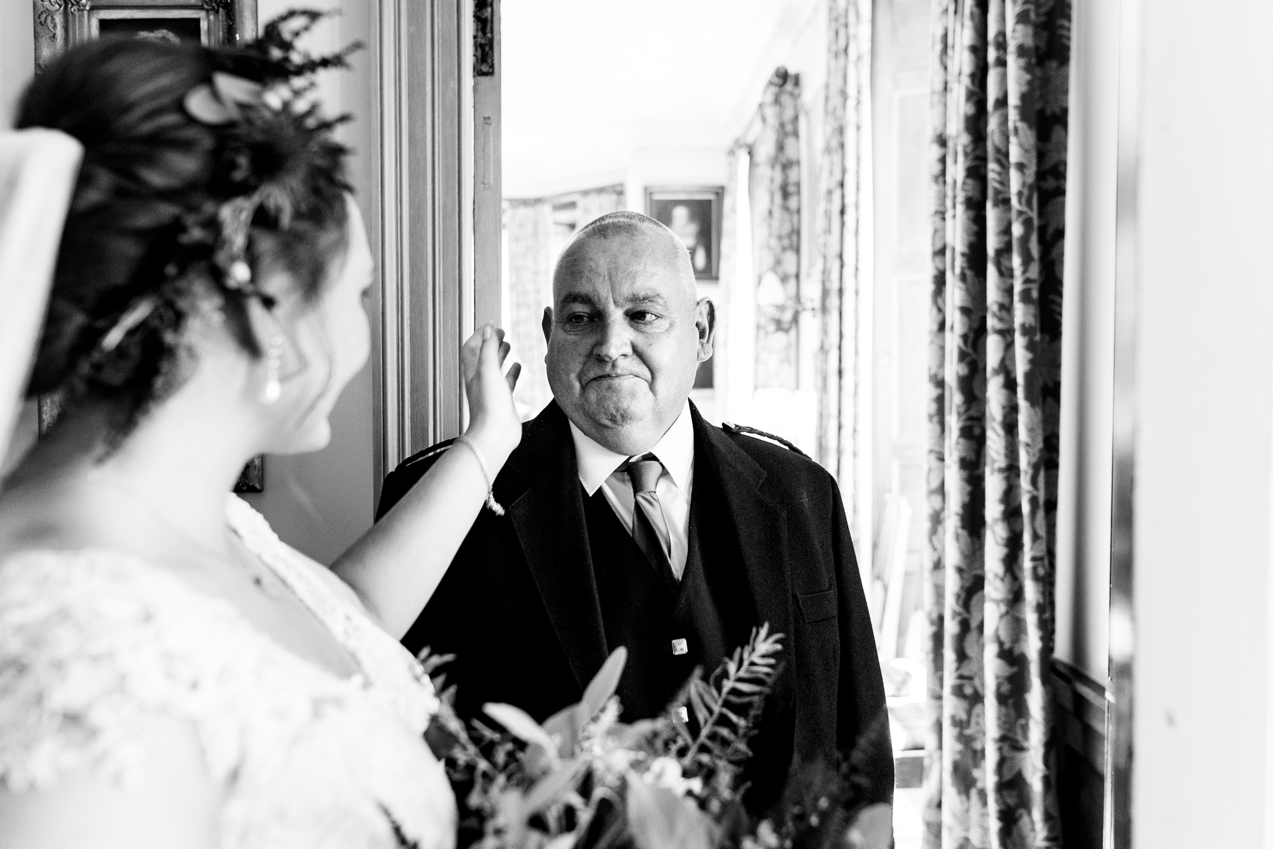 father of bride sees her in the dress for the first time. scotland wedding photography by emma and rich.