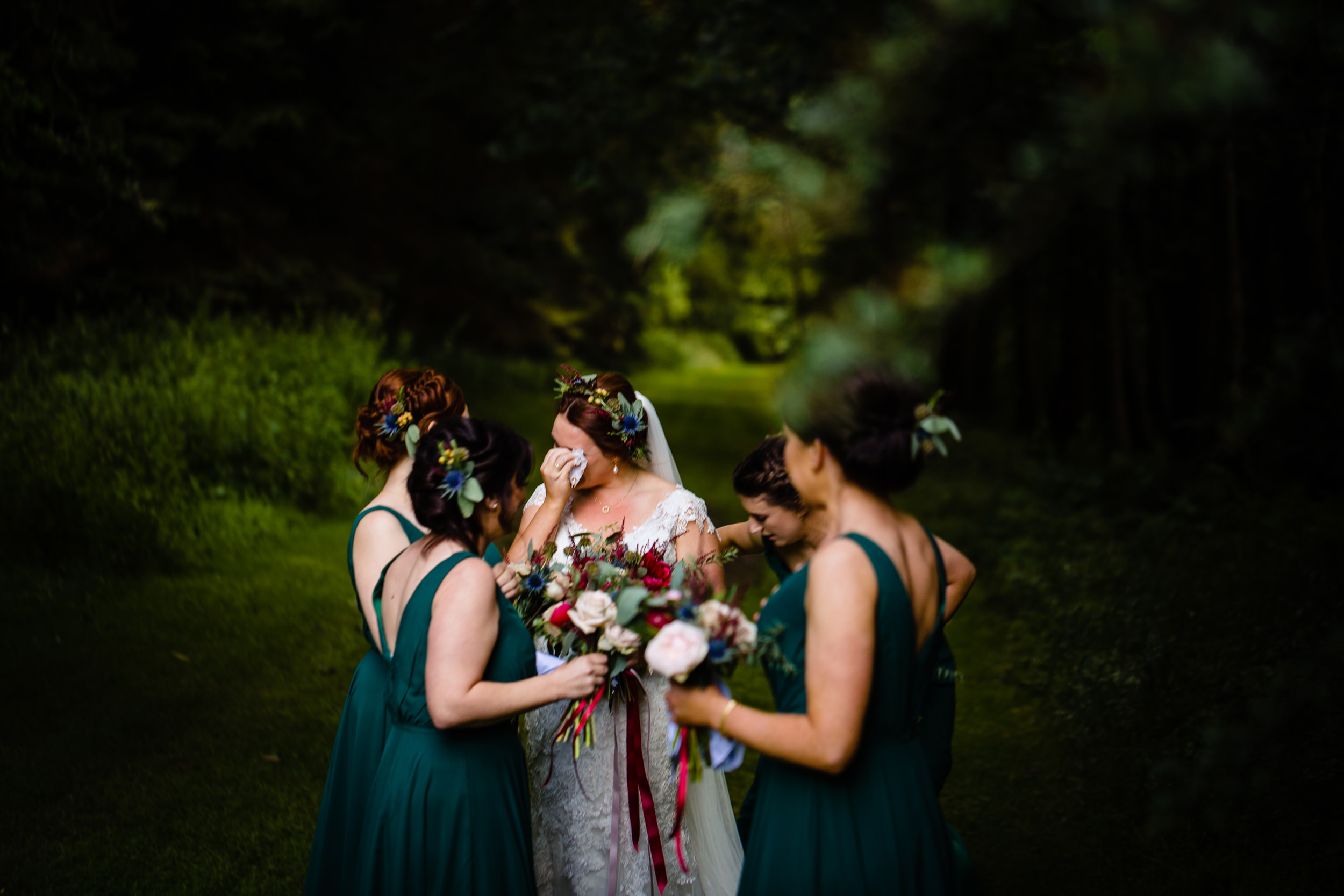 tearful bride with bridesmaids. scotland wedding photography by emma and rich.