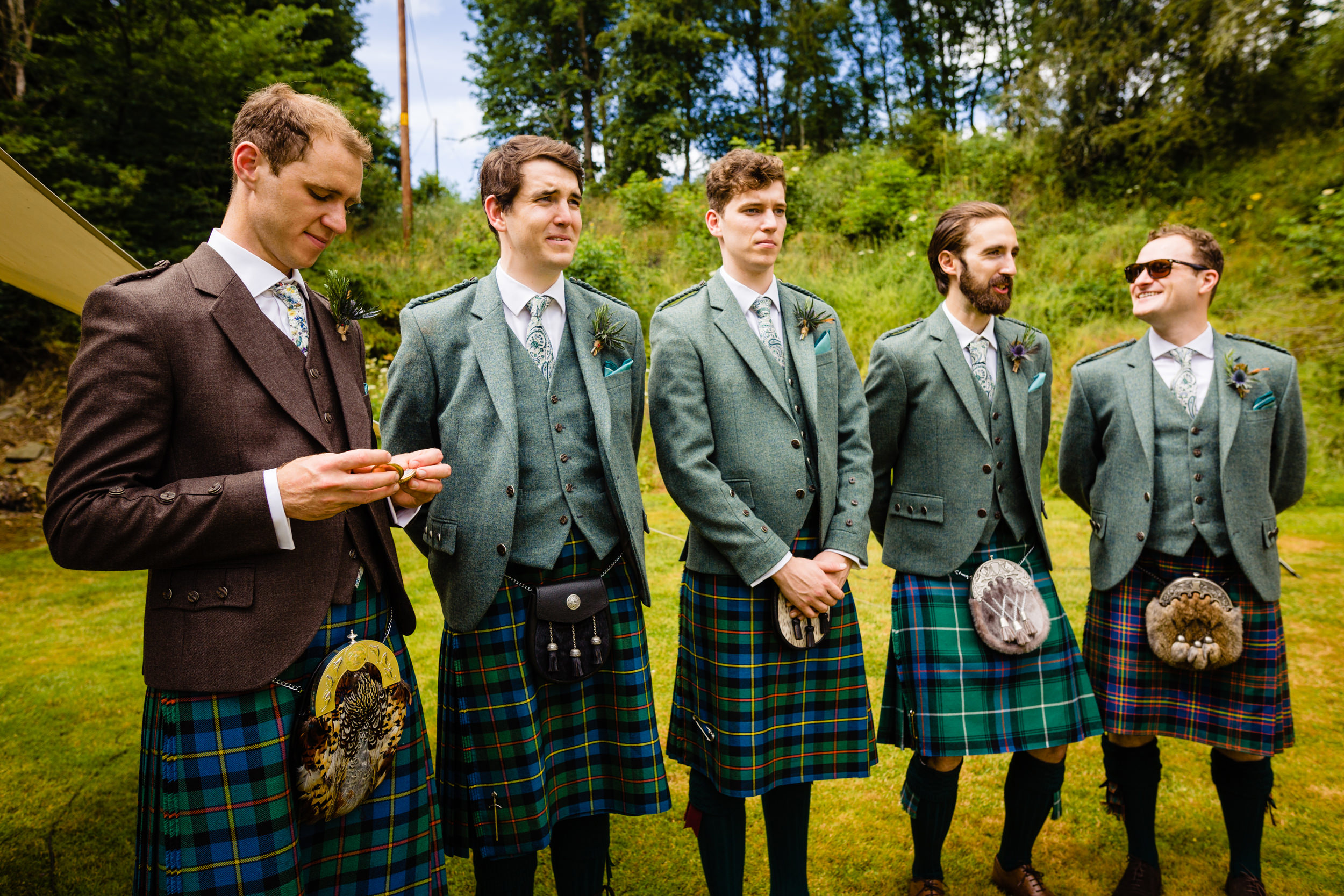 groom checking pocket watch. scotland wedding photography by emma and rich.