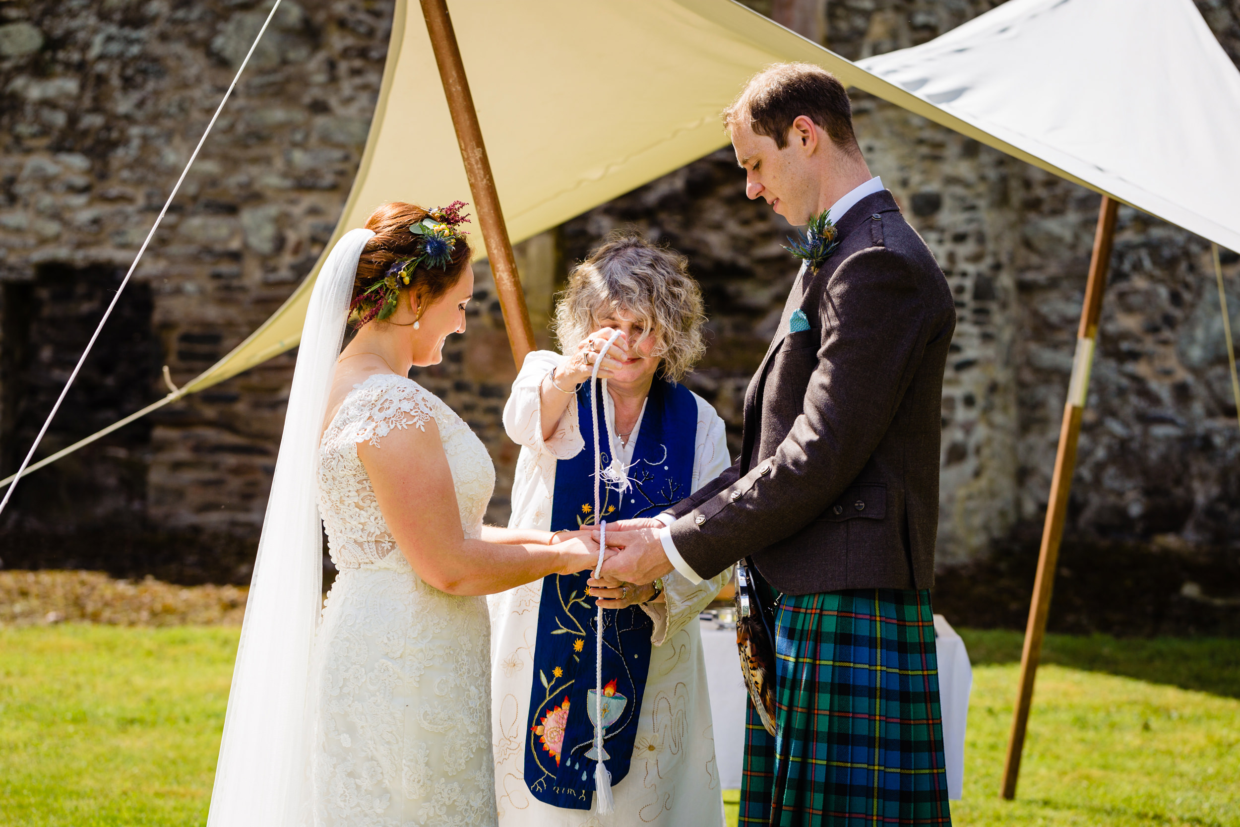 hand fastening ceremony. scotland wedding photography by emma and rich.