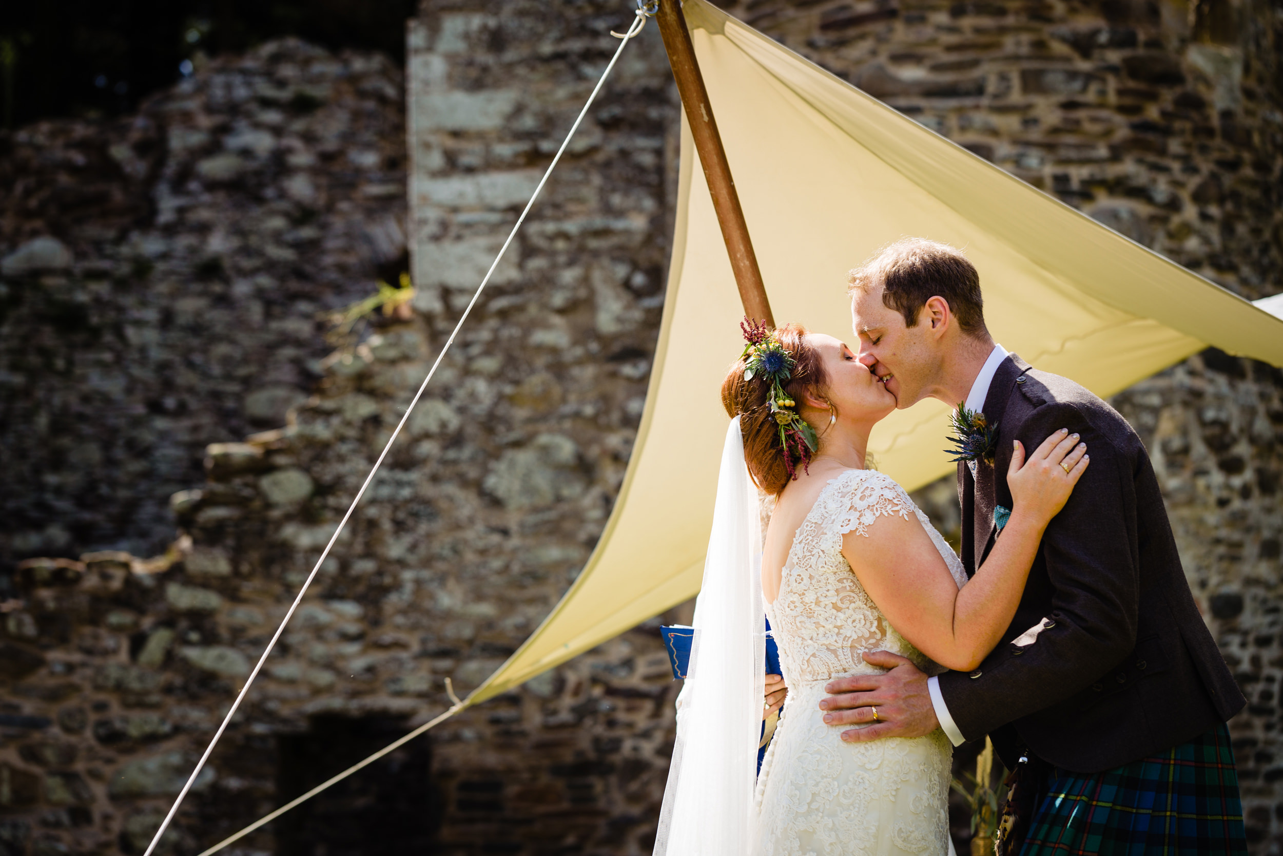 bride and grooms first kiss. scotland wedding photography by emma and rich.