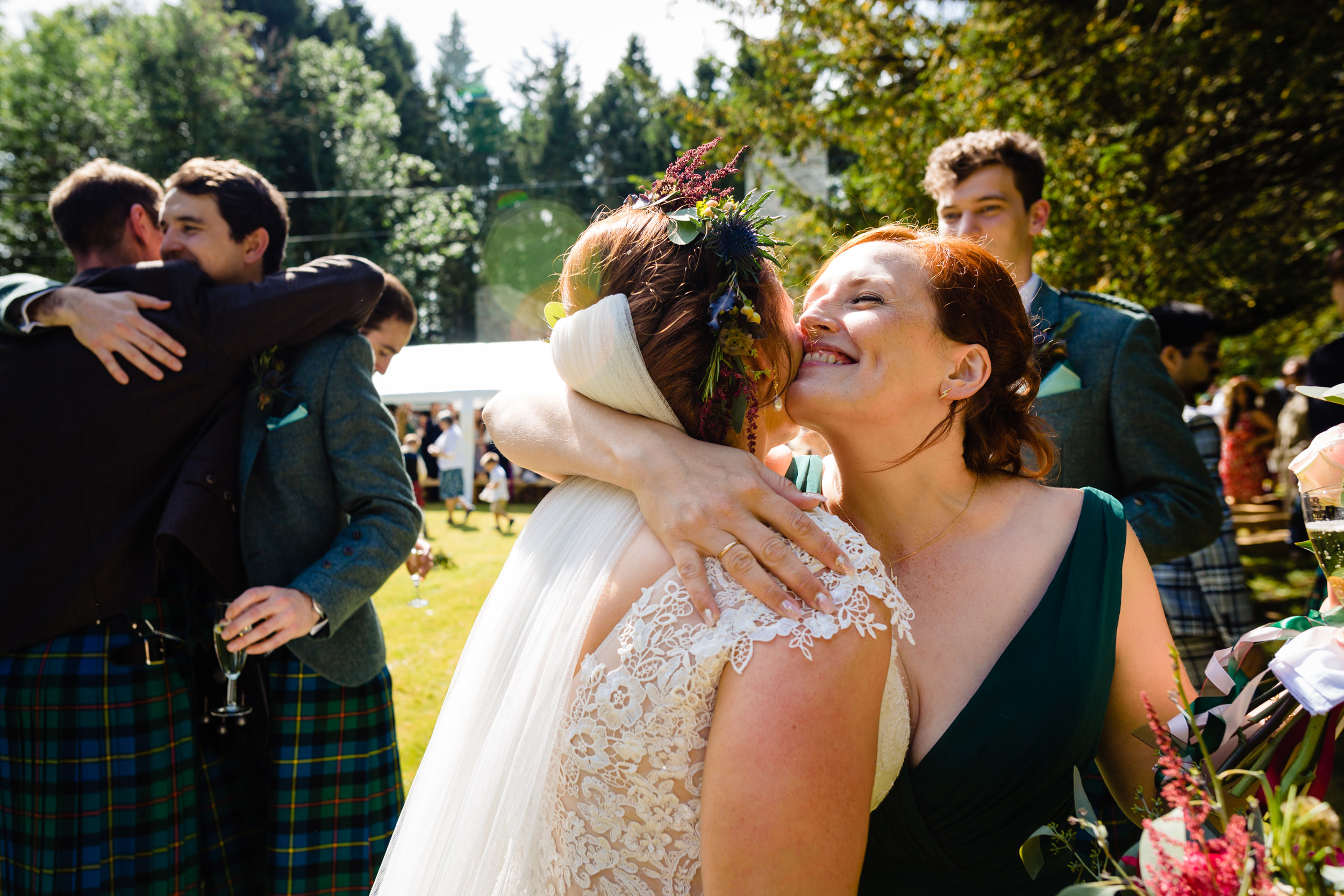 congratulatory hugs after the wedding. scotland wedding photography by emma and rich.