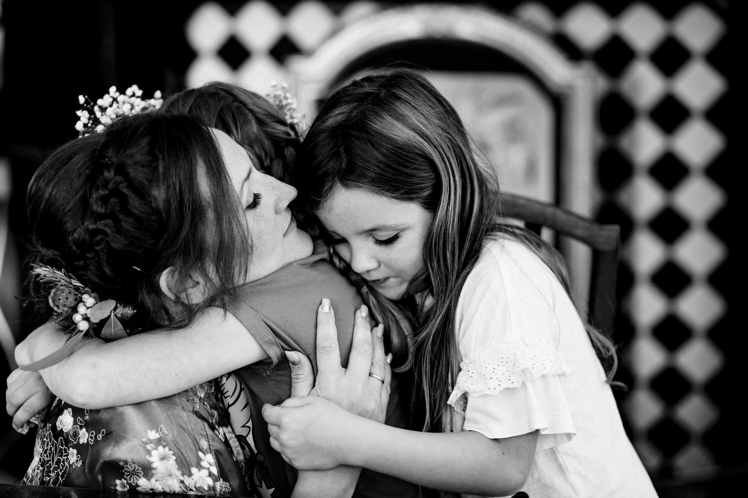 bridesmaid hugging flower girls. scotland wedding photography by emma and rich.
