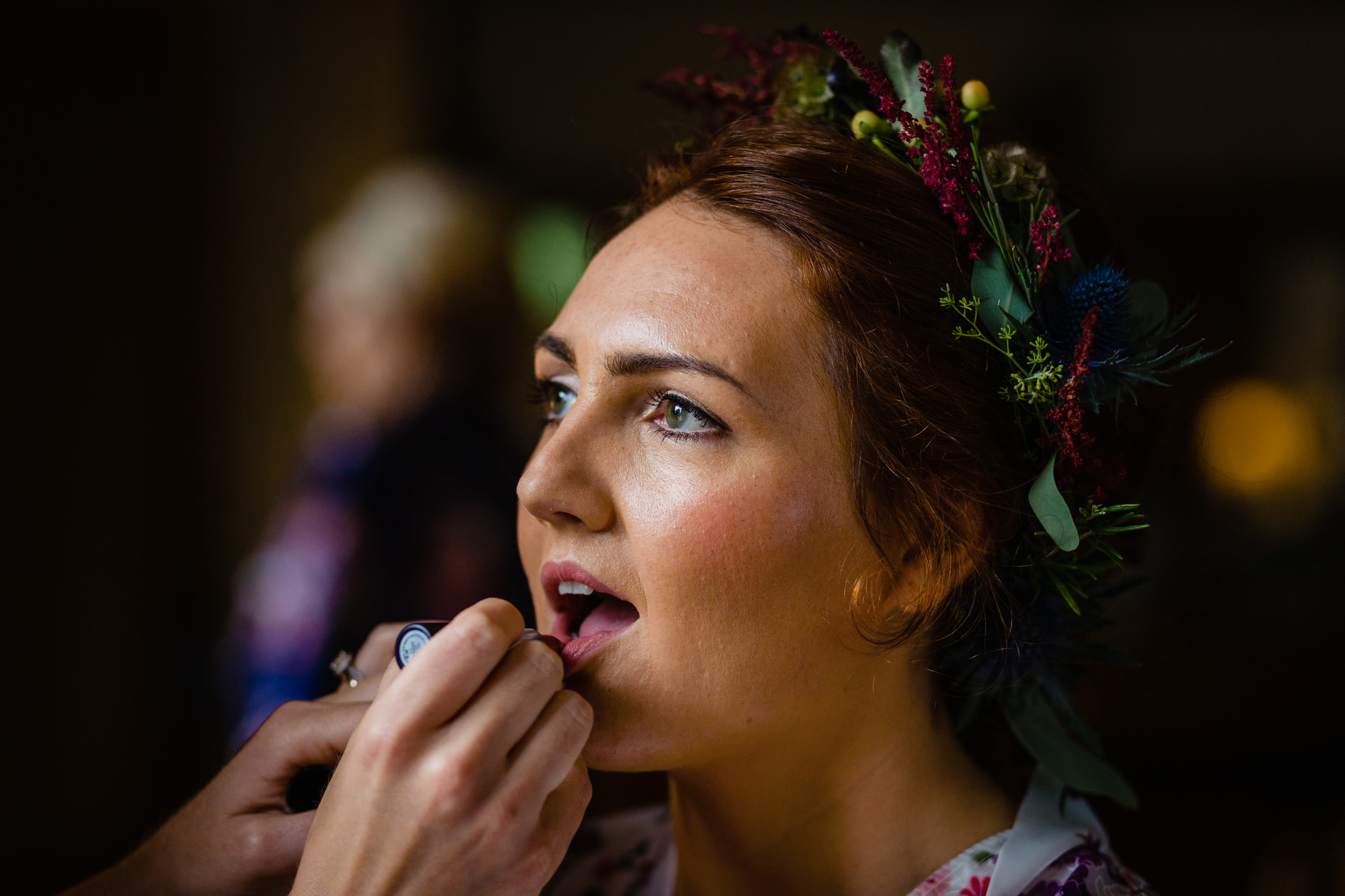 bride having lipstick applied. scotland wedding photography by emma and rich.