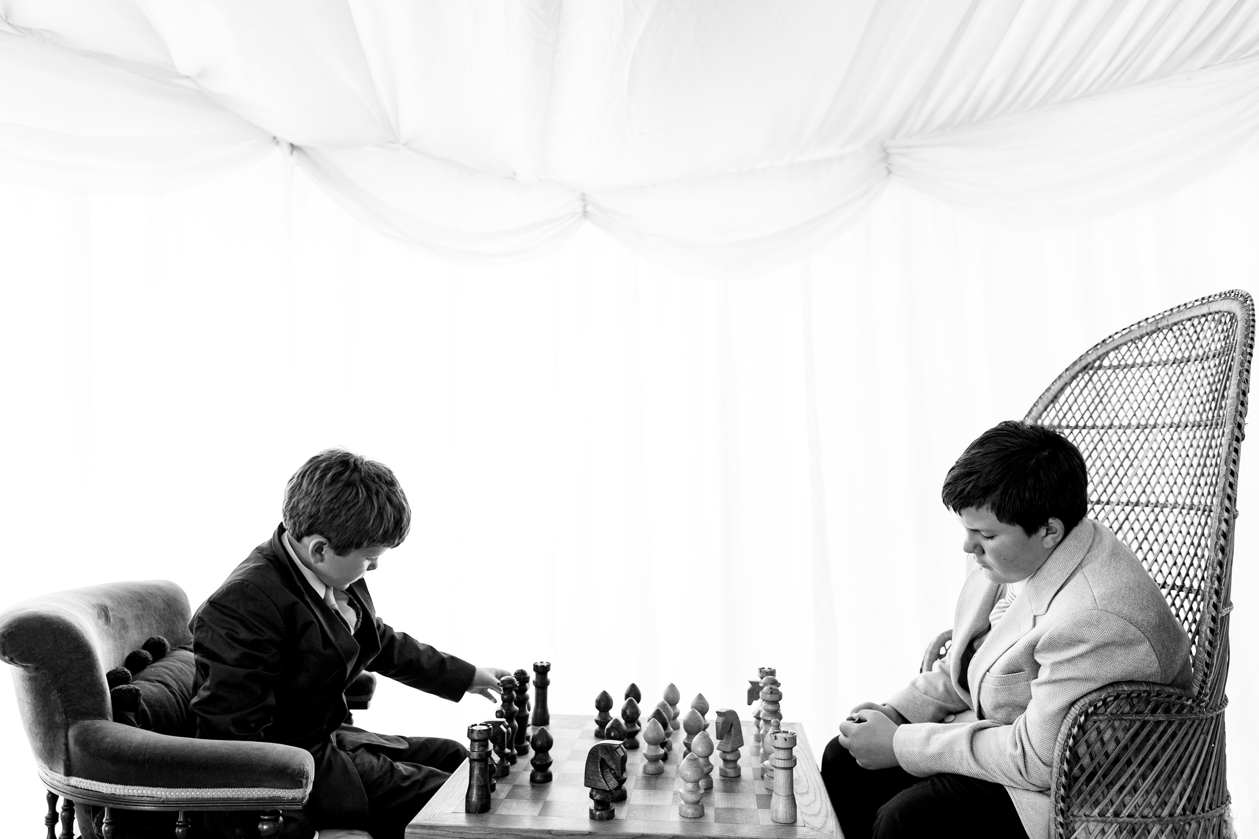 two boys playing chess. scotland wedding photography by emma and rich.