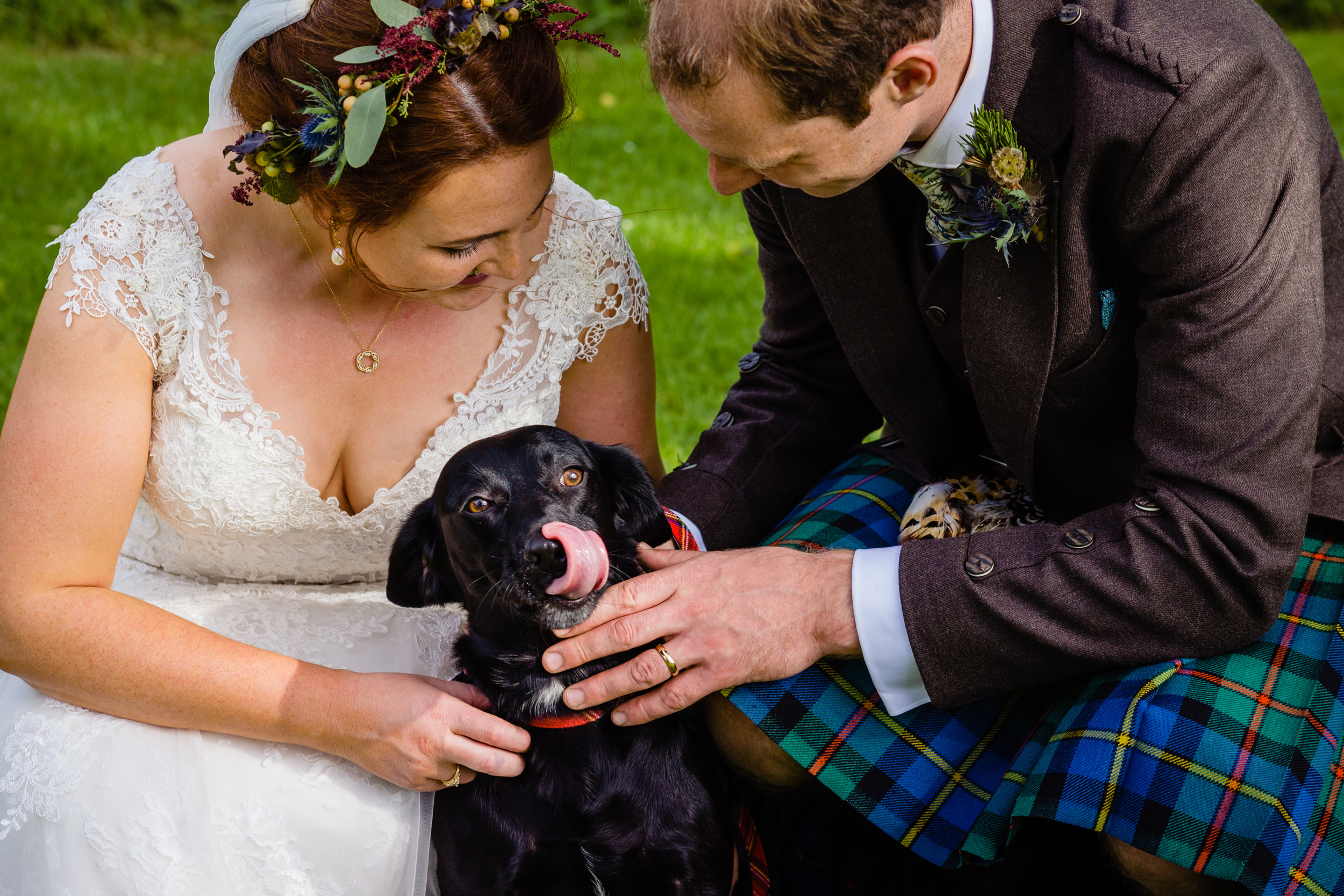 bride and groom with their dog. scotland wedding photography by emma and rich.
