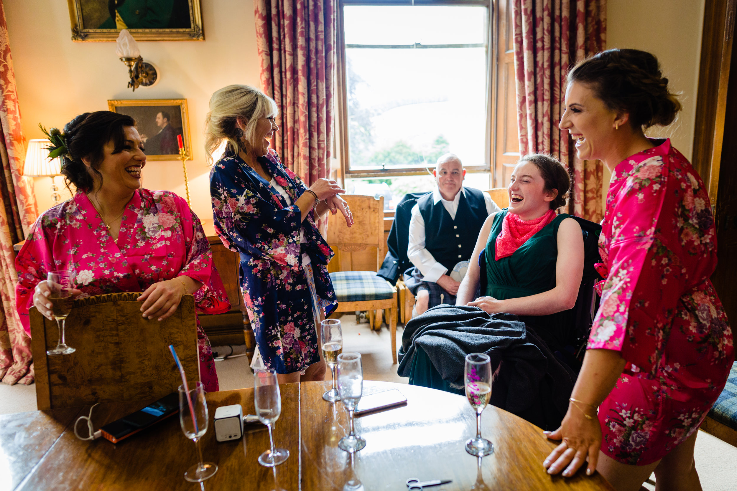 bridesmaids laughing during prep. scotland wedding photography by emma and rich.