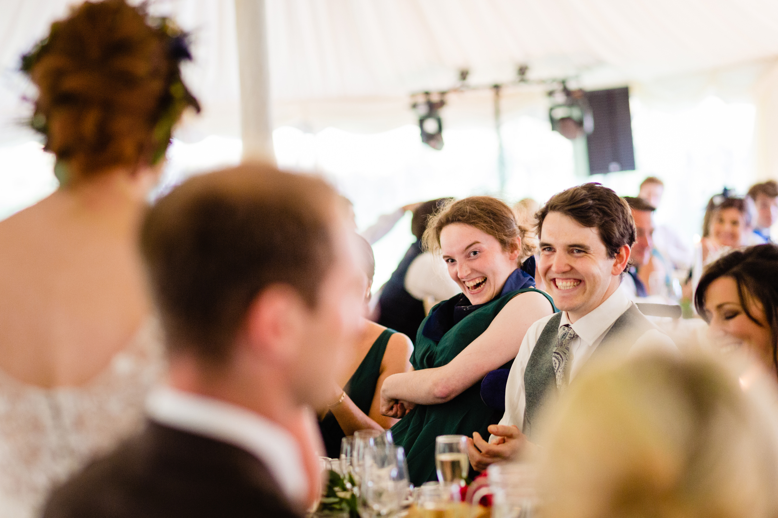 guests laughing at speech. scottish wedding photography.