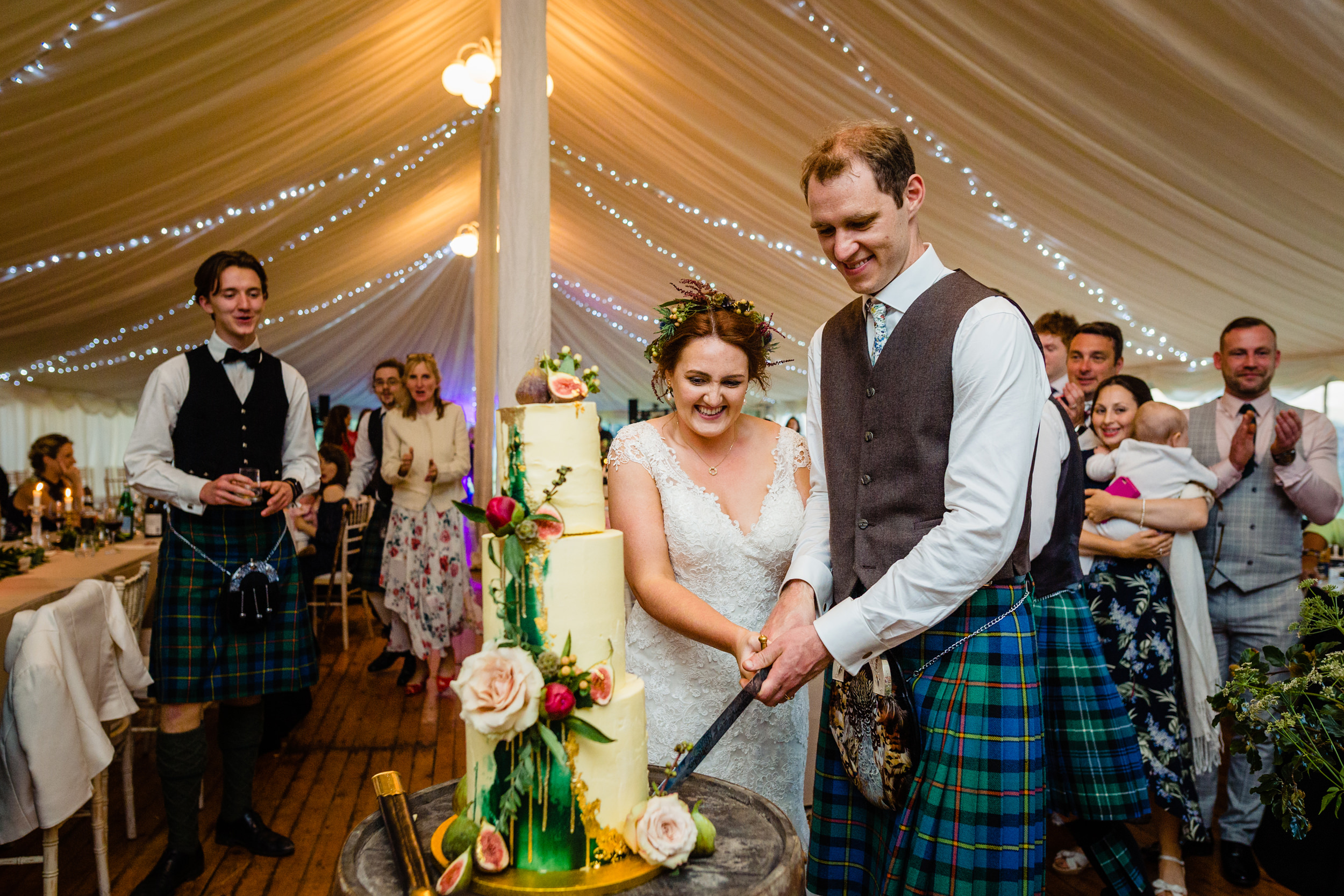 bride and groom cut the cake. scottish wedding photography.