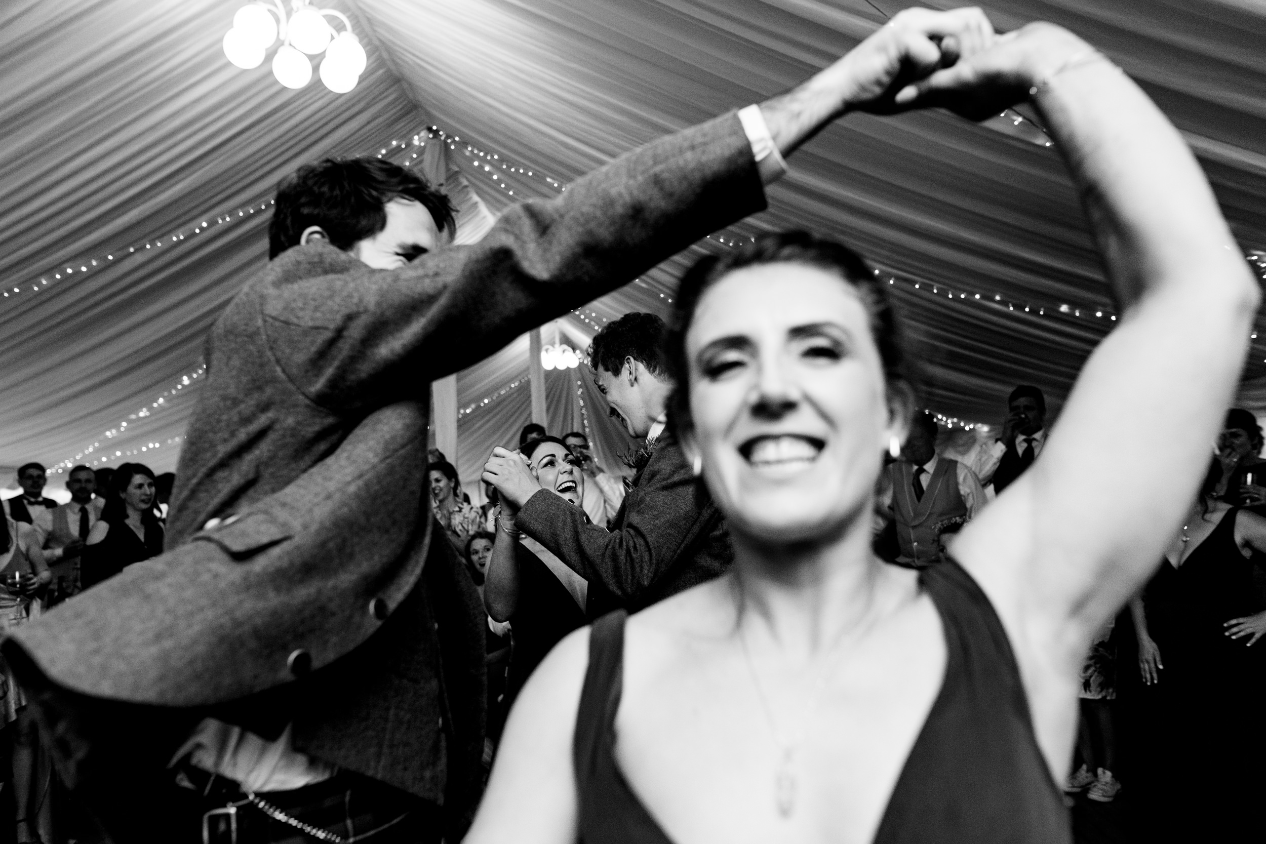 guests dancing in a ceilidh. scottish wedding photography.