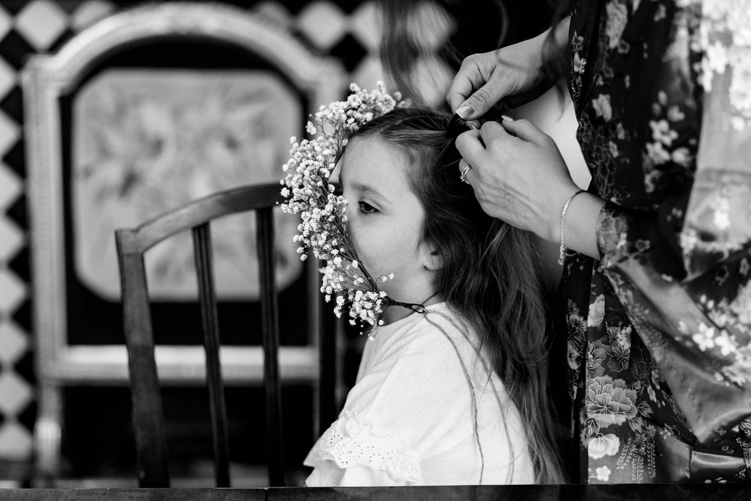 flower girl getting hair and flower crown fixed. scotland wedding photography by emma and rich.