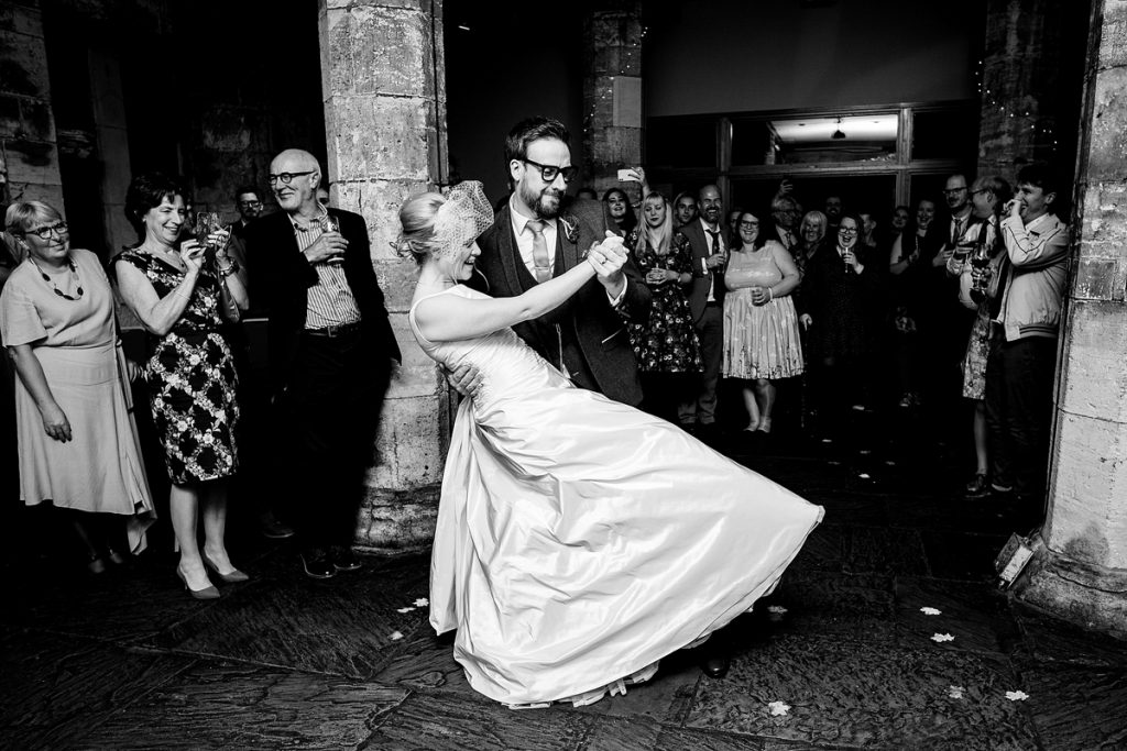 how to choose a wedding photographer. a bride and groom's first dance.