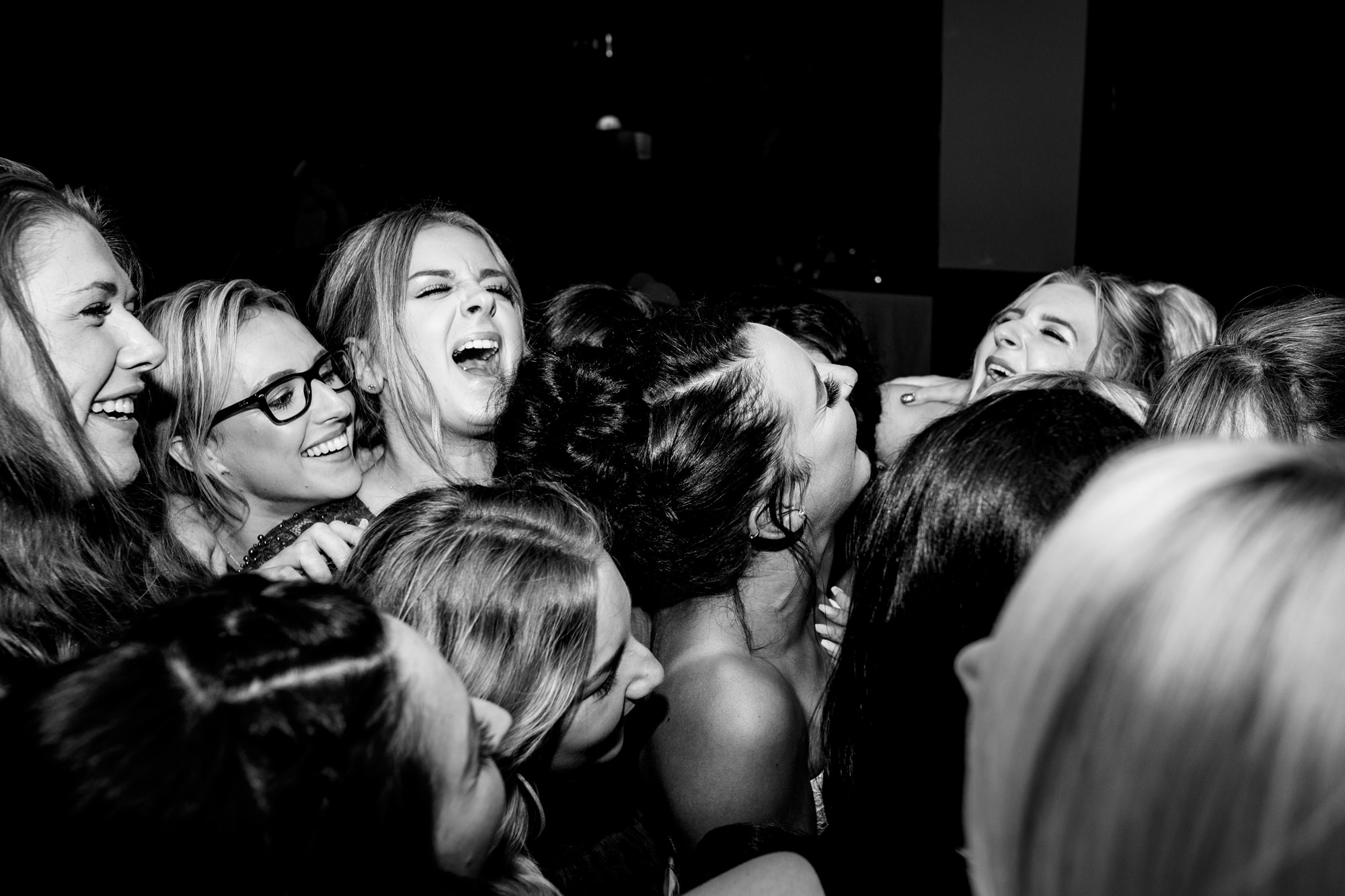 group hug with the bride in the middle. huntsman inn wedding photography by emma and rich.
