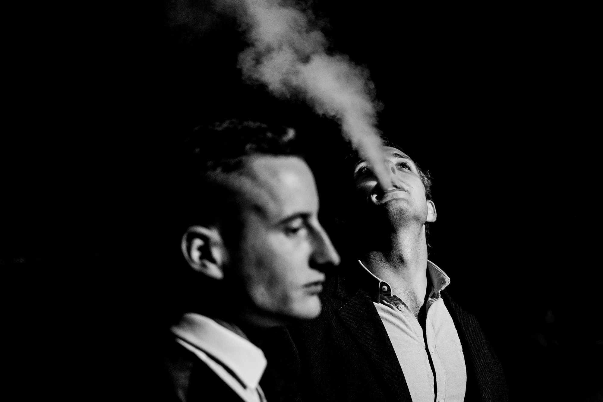 guests vaping outside a wedding reception. huntsman inn wedding photography by emma and rich.