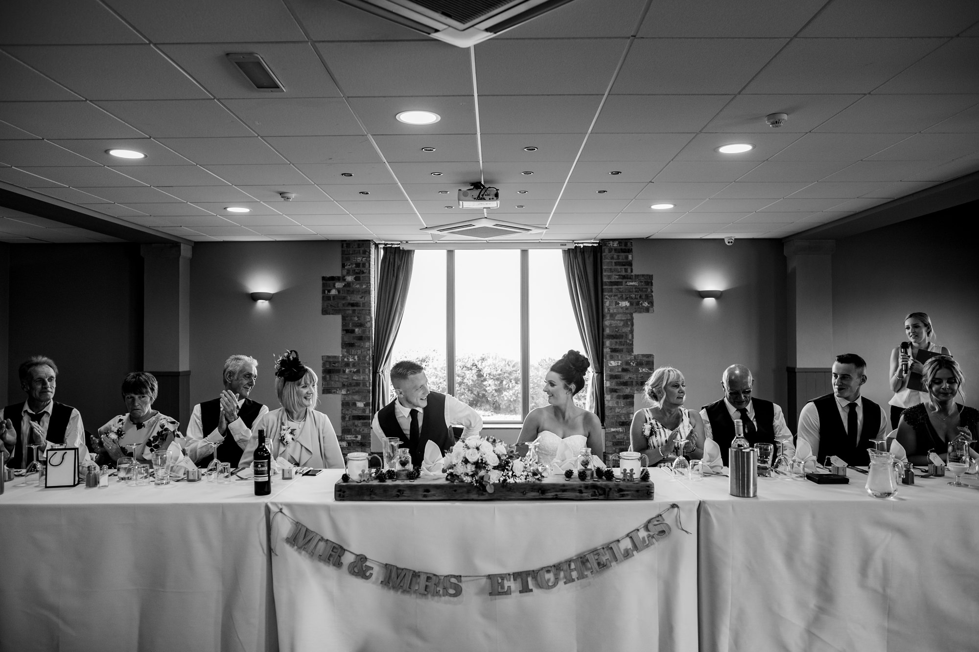 wide shot of everyone sat at the top table. huntsman inn wedding photography by emma and rich.