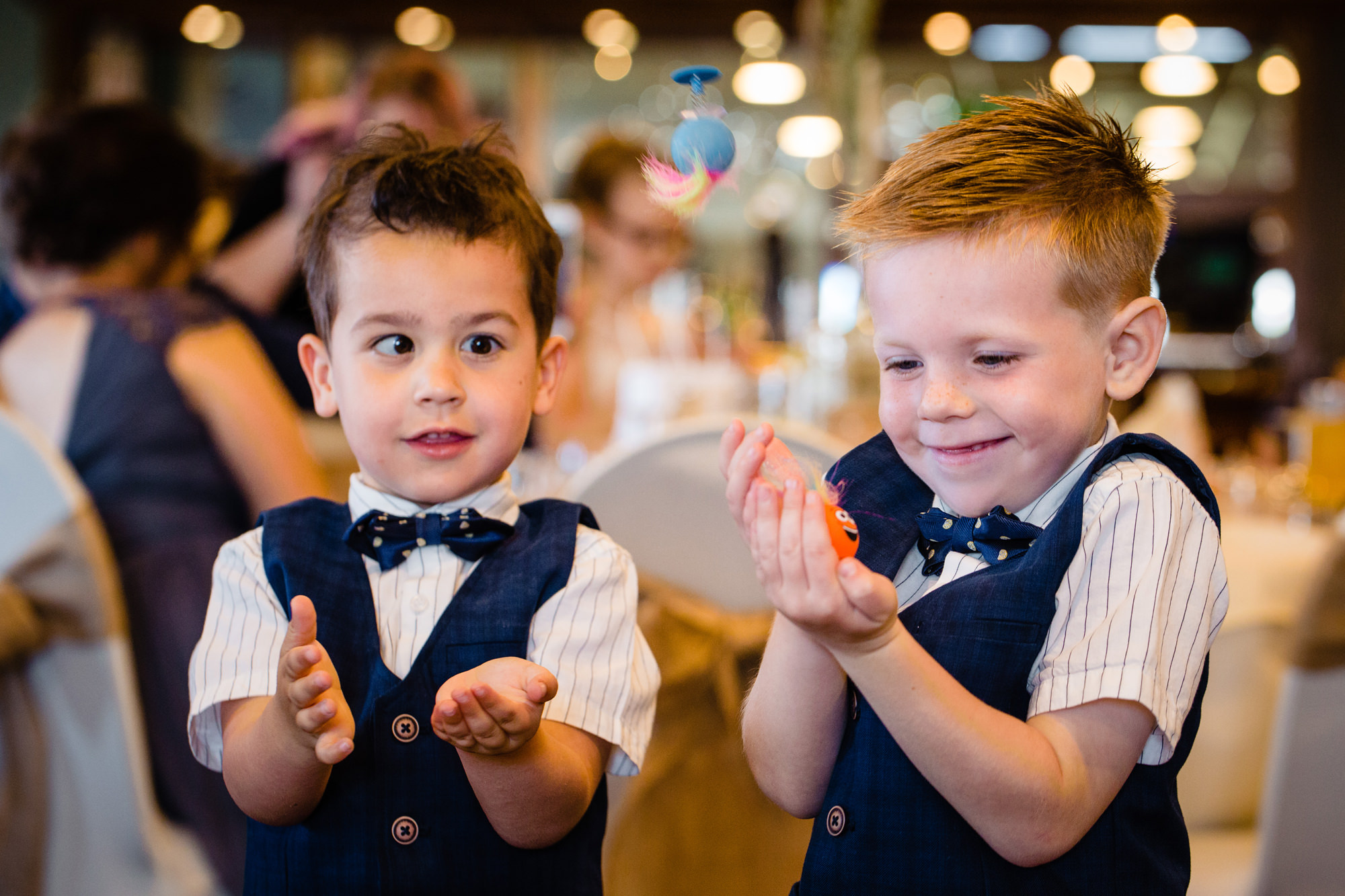 two page boys playing with the toys they got for wedding favours. huntsman inn wedding photography by emma and rich.