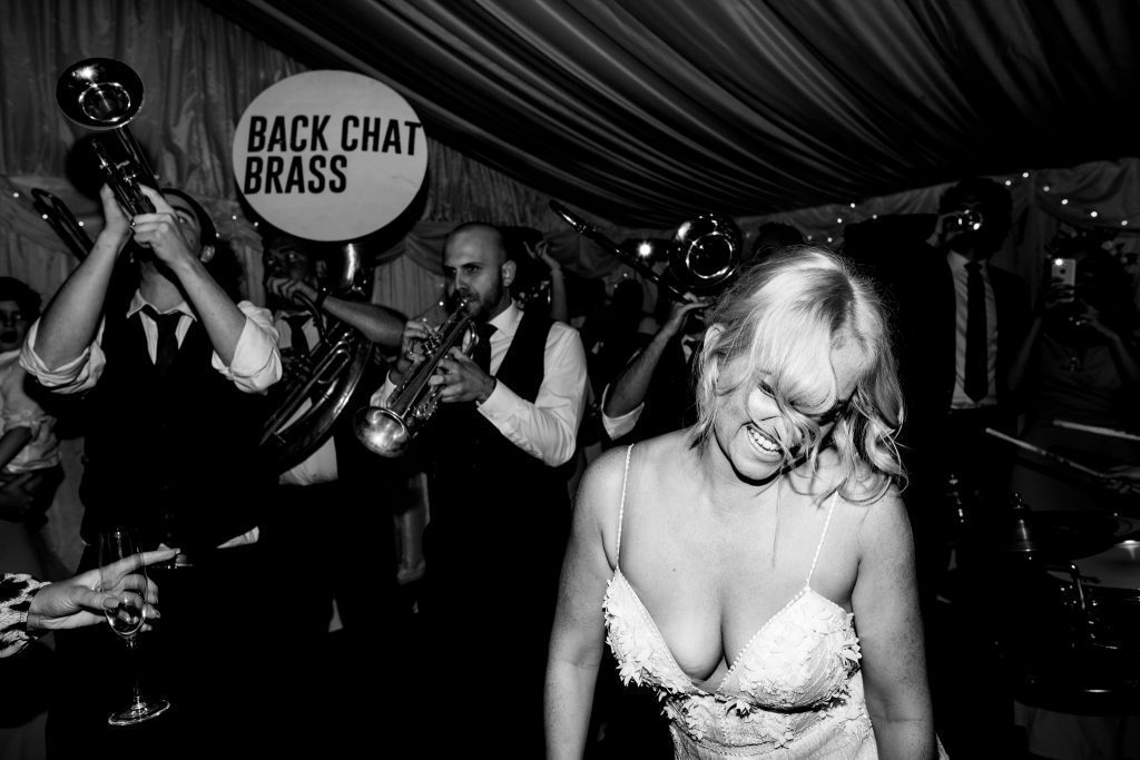 bride dancing to back chat brass york house wedding photography by emma and rich