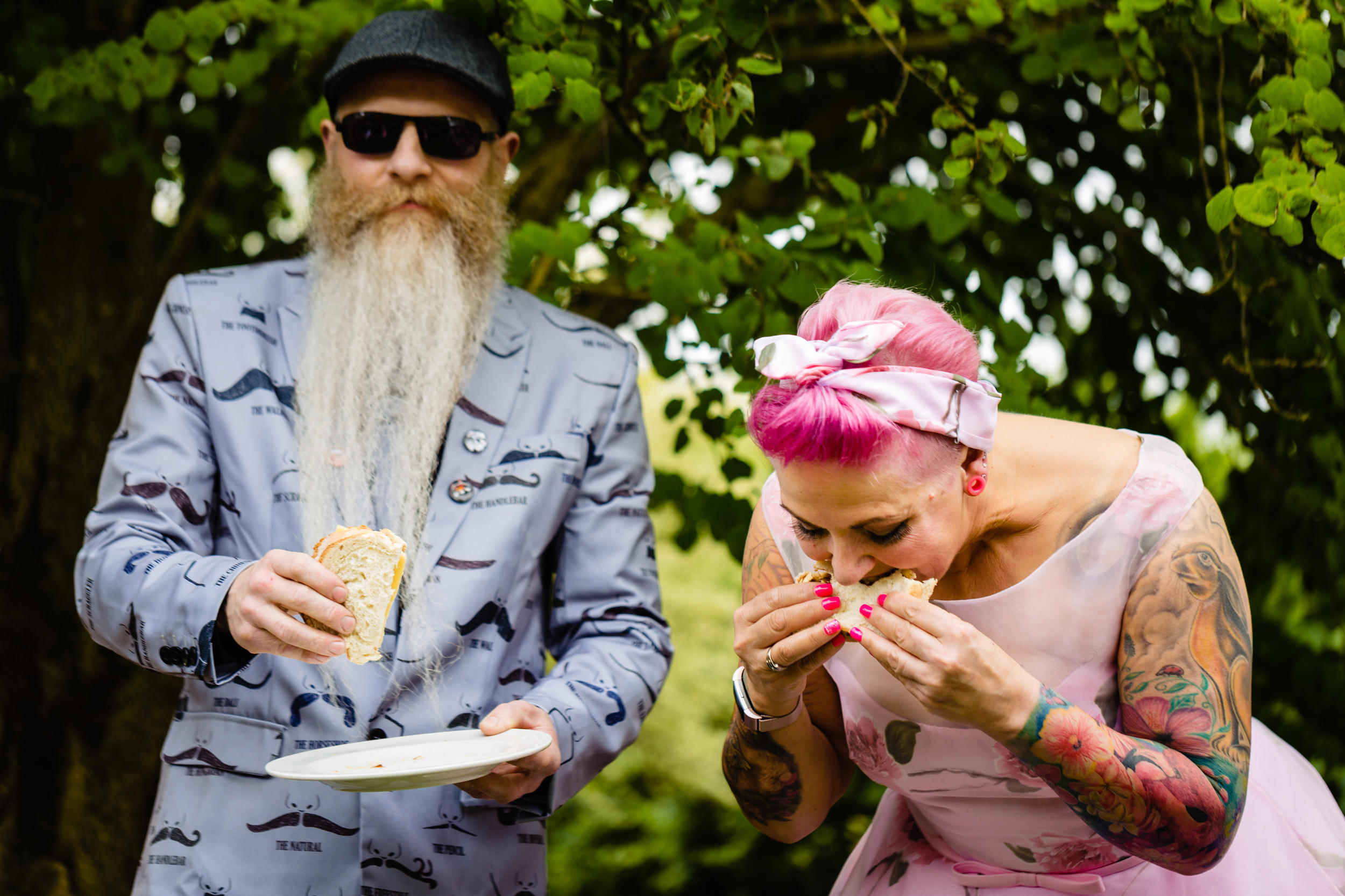bride and groom eating sandwiches during the ceremony. wold top brewery wedding photography by emma and rich.