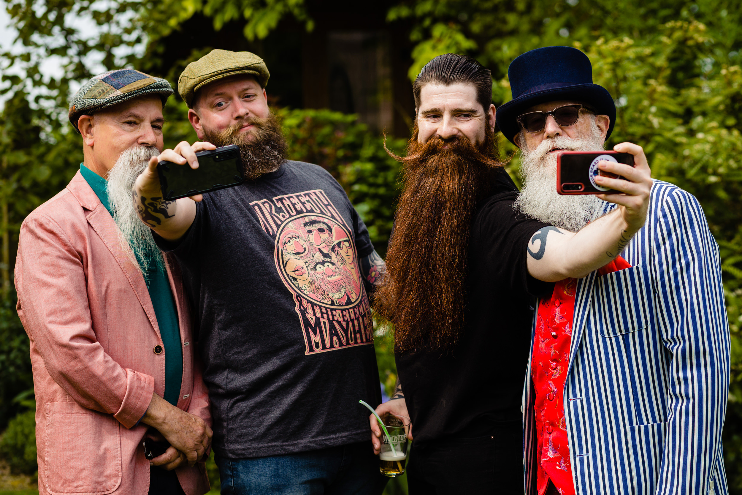 champion beard growers taking selfies.
