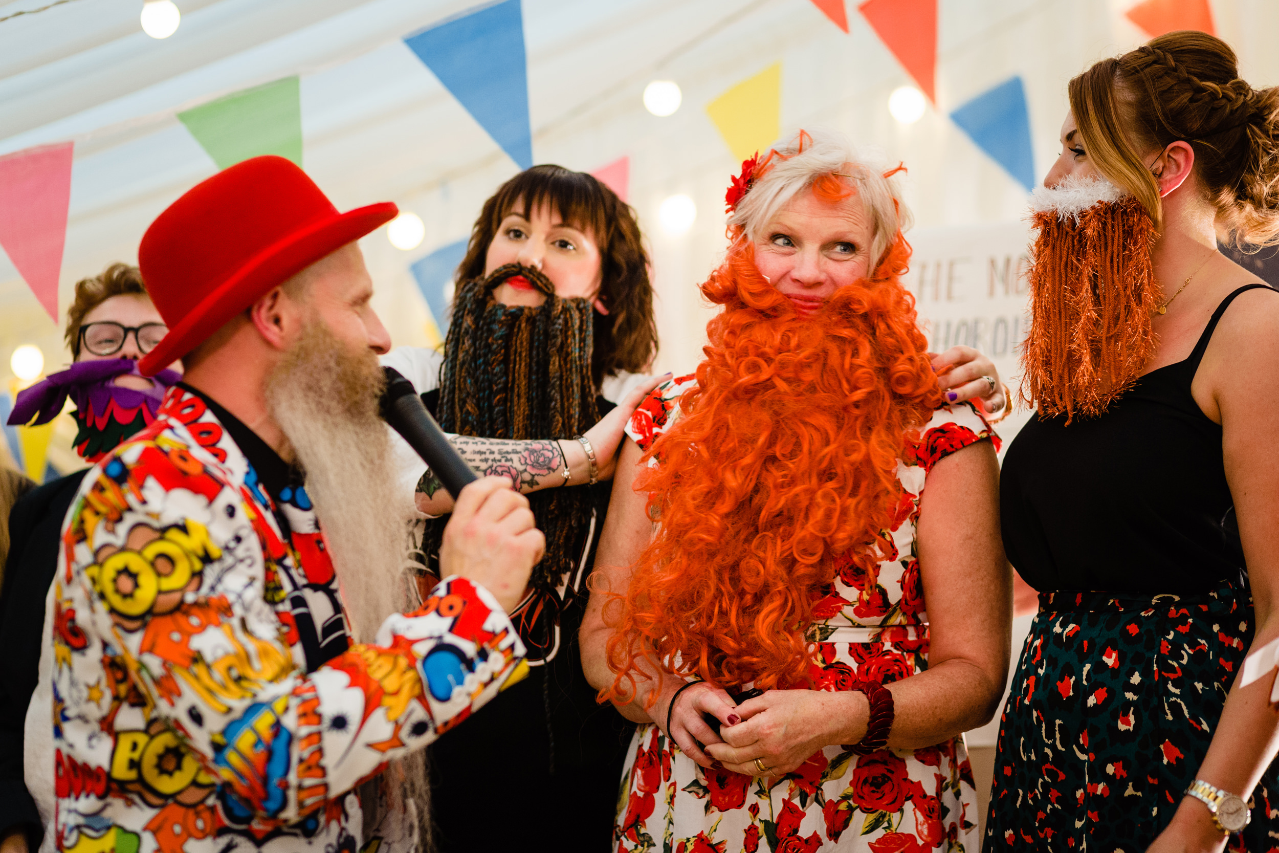 ladies with handcrafted beards enter the beard competition. wold top brewery wedding photography by emma and rich.