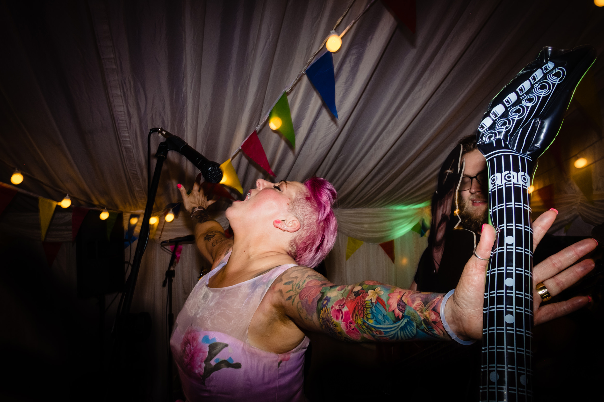 bride hits the mic with the band. wold top brewery wedding photography by emma and rich.