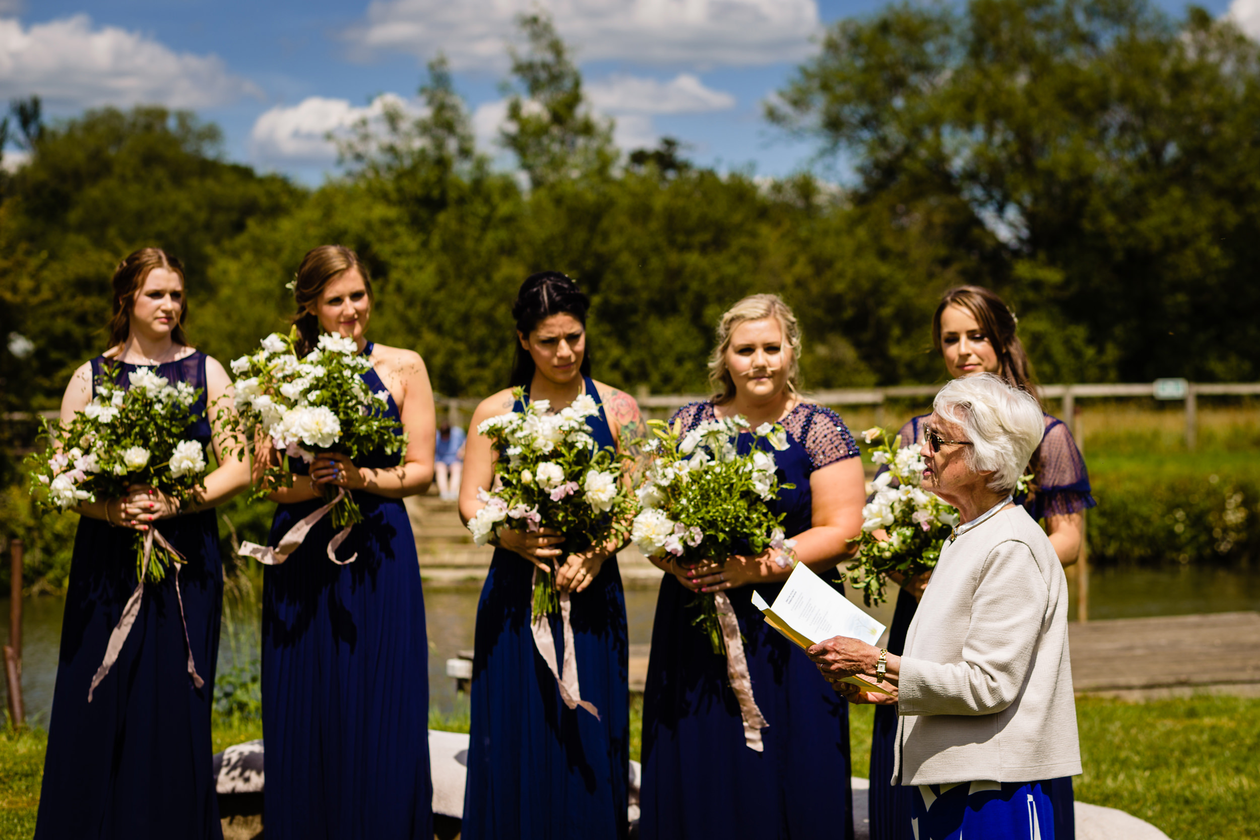 grandma gives reading watched by bridesmaids. maybush wedding co wedding photography by emma and rich.