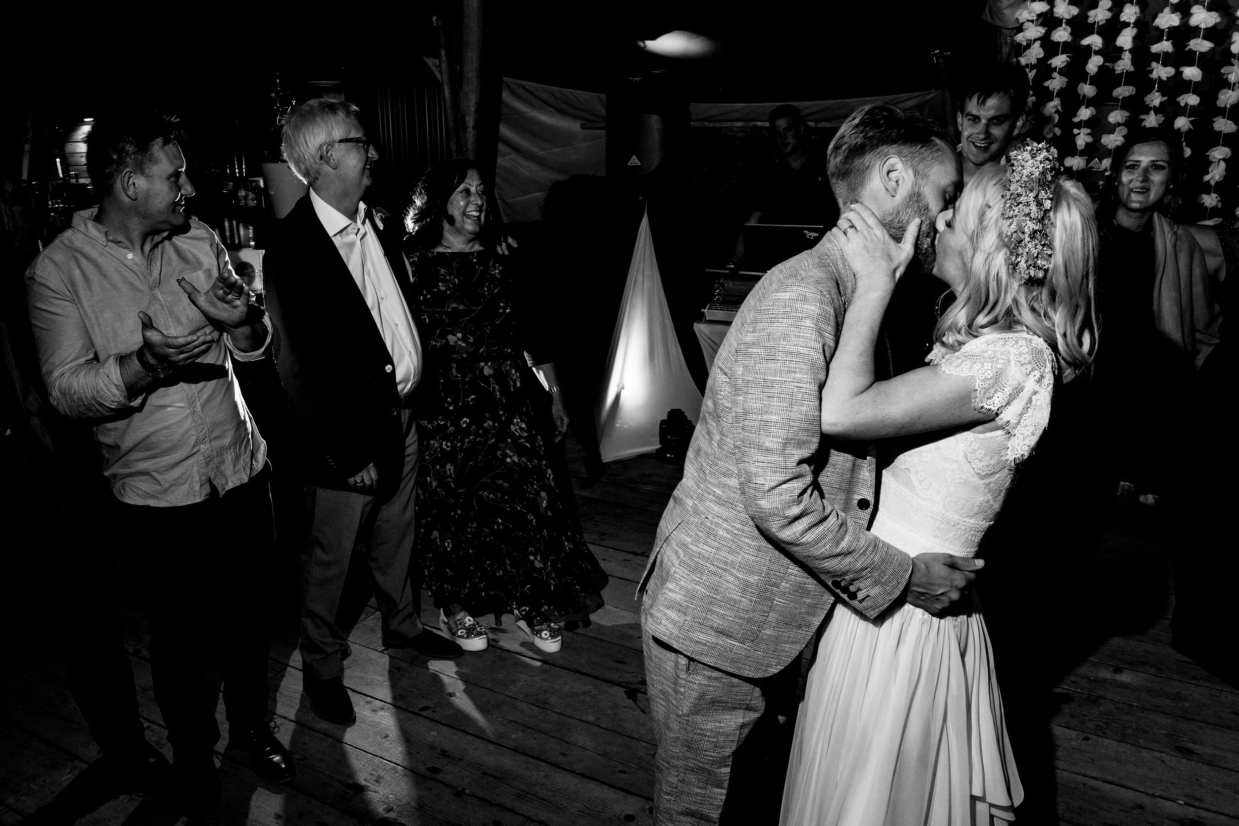 bride and groom kiss on dancefloor. maybush wedding co wedding photography by emma and rich.